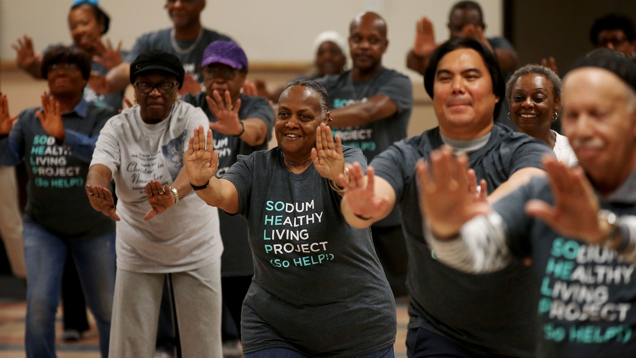 Participants in the Sodium Healthy Living Project perform tai chi at Holman Methodist Church.