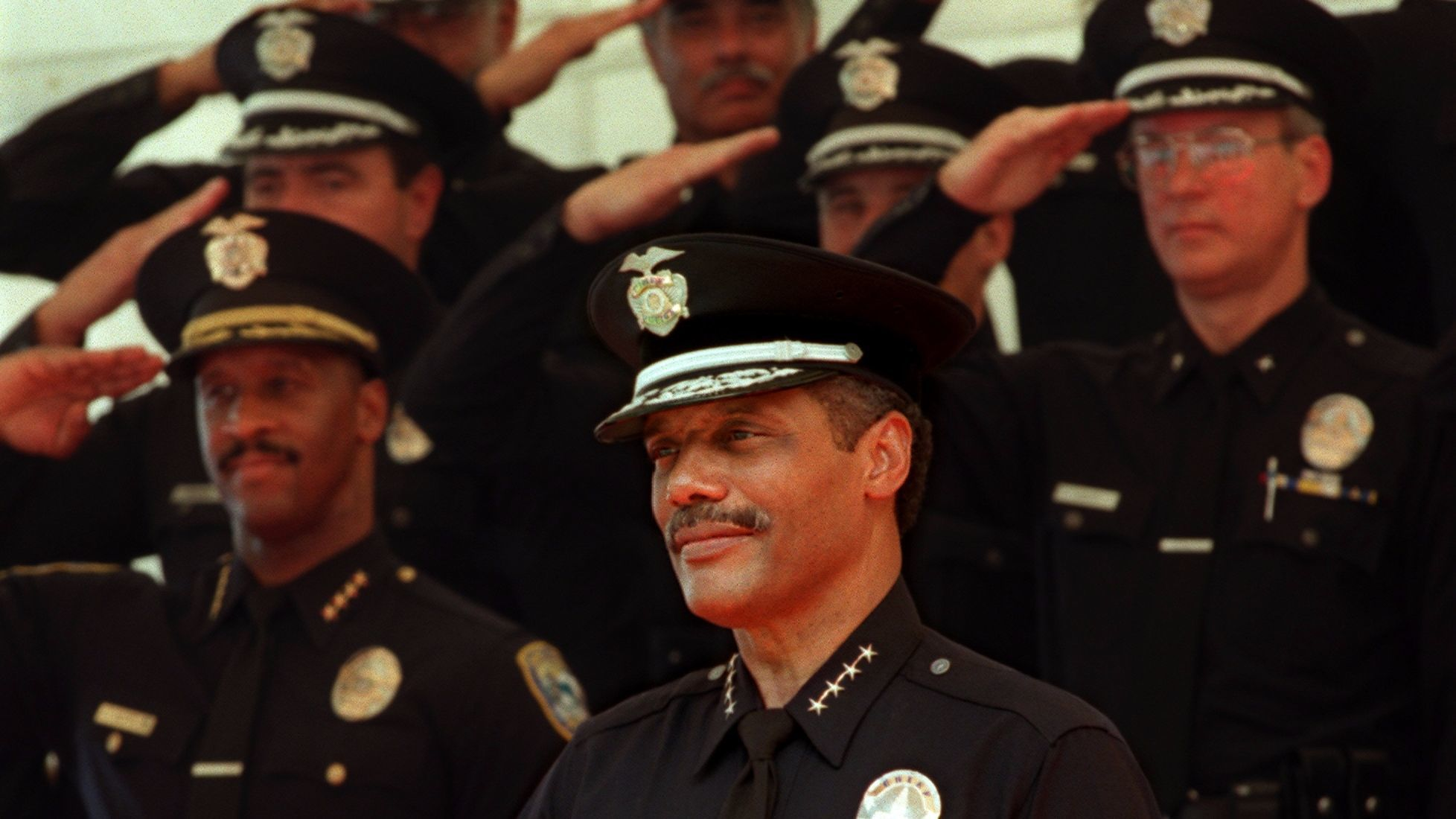 Bernard C. Parks receives a salute from officers as he is formally sworn in as the LAPD's chief in 1997.