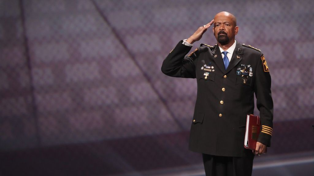 David Clarke Jr., sheriff of Milwaukee County, Wisconsin, salutes as he leaves the stage after speaking at the NRA-ILA's Leadership Forum at the 146th NRA Annual Meetings & Exhibits on April 28, 2017 in Atlanta, Georgia.