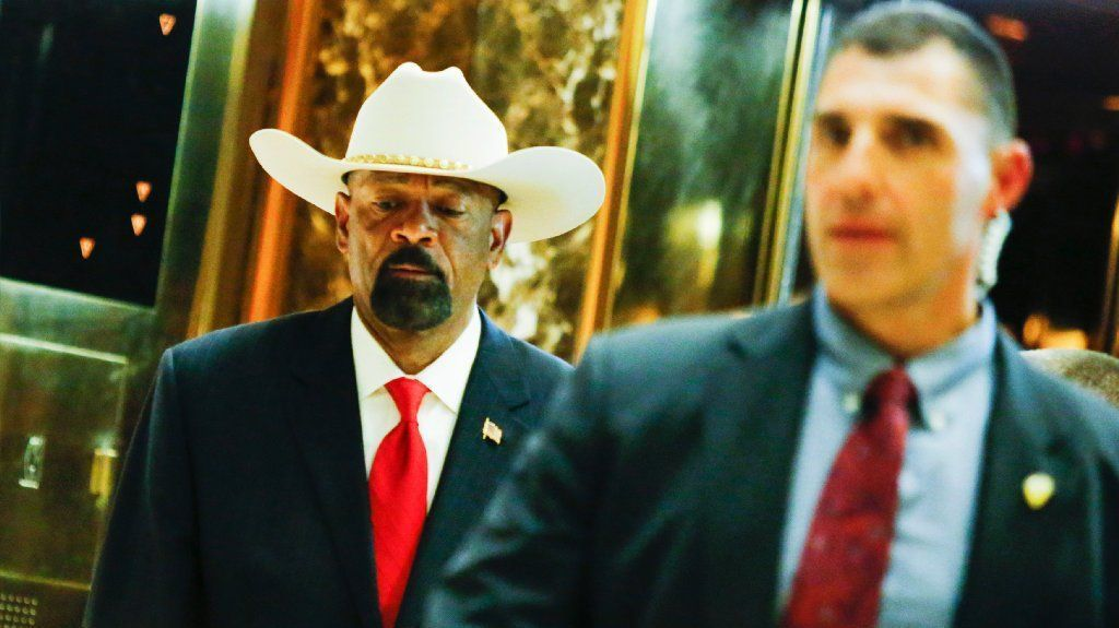 Milwaukee Sheriff David Clarke (L) exits elevators after meetings with President-elect Donald Trump November 28, 2016 at the Trump Tower in New York