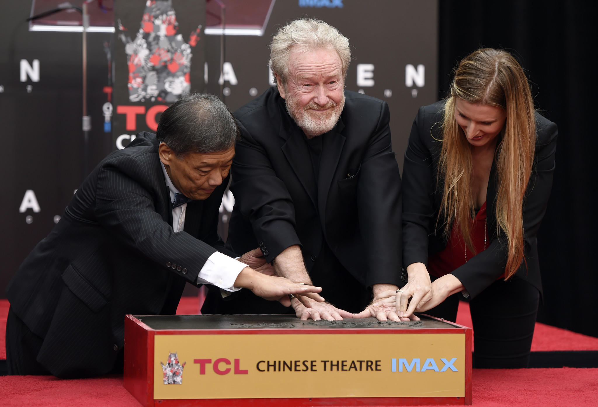 "Sir Ridley Scott, director of ""Alien: Covenant"" presses his handprints into cement during a ceremony for him at the TCL Chinese Theatre on Wednesday, May 17, 2017."