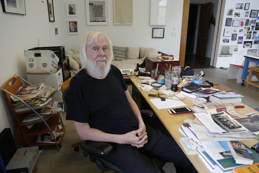 Baldessari at his art studio desk.