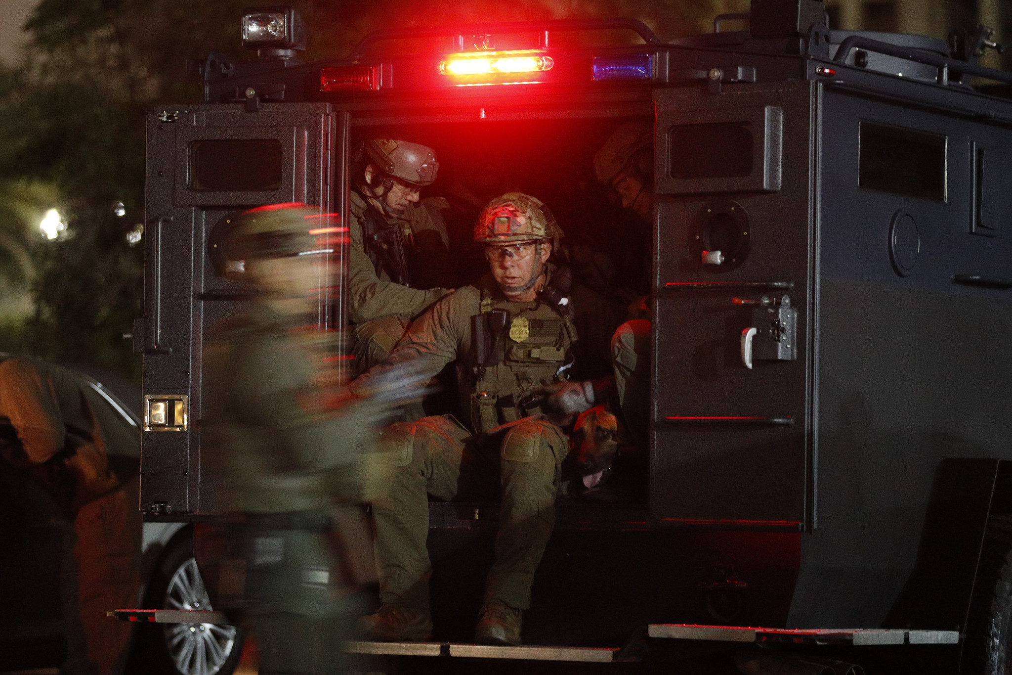 ATF agents board a truck to conduct a raid early Wednesday morning in Los Angeles.