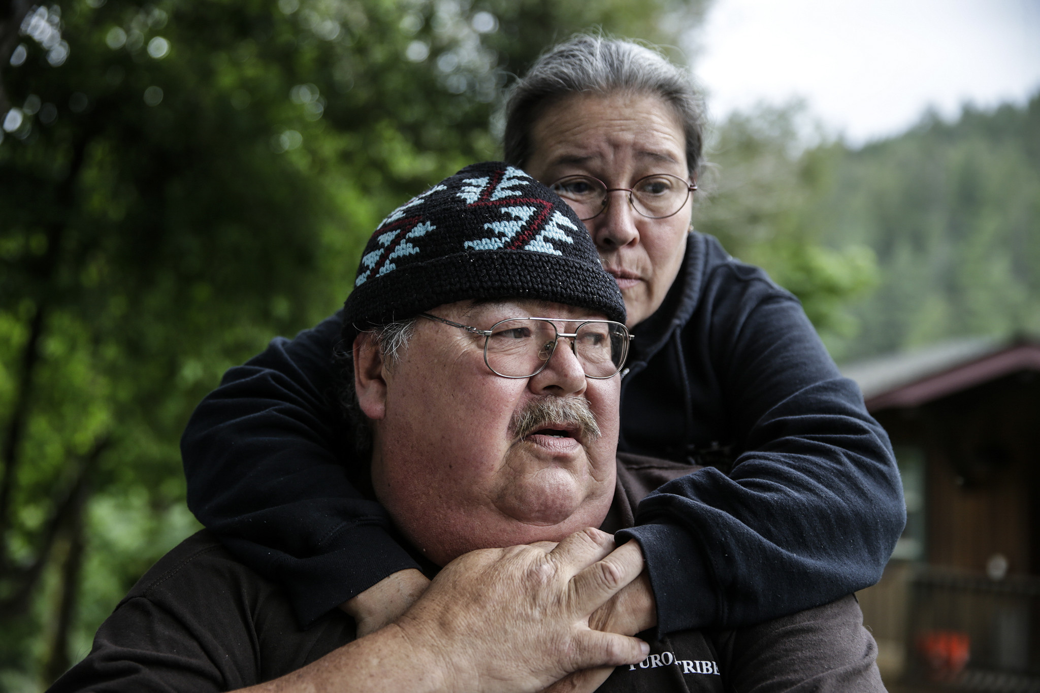 Dan French is comforted by his cousin Elizabeth Azzuz as he talks about his son's suicide.