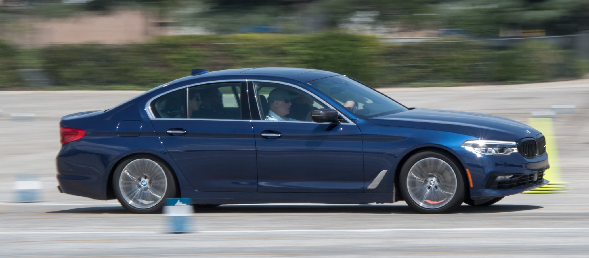 At speed in a BMW 5 Series sedan on the autocross course