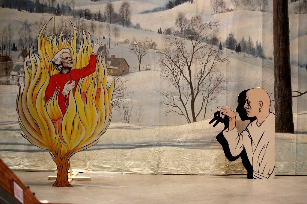 Barbara Bush goes up in flames as a soul purified in purgatory while occultist  Aleister Crowley looks on in Jim Shaw's installation,