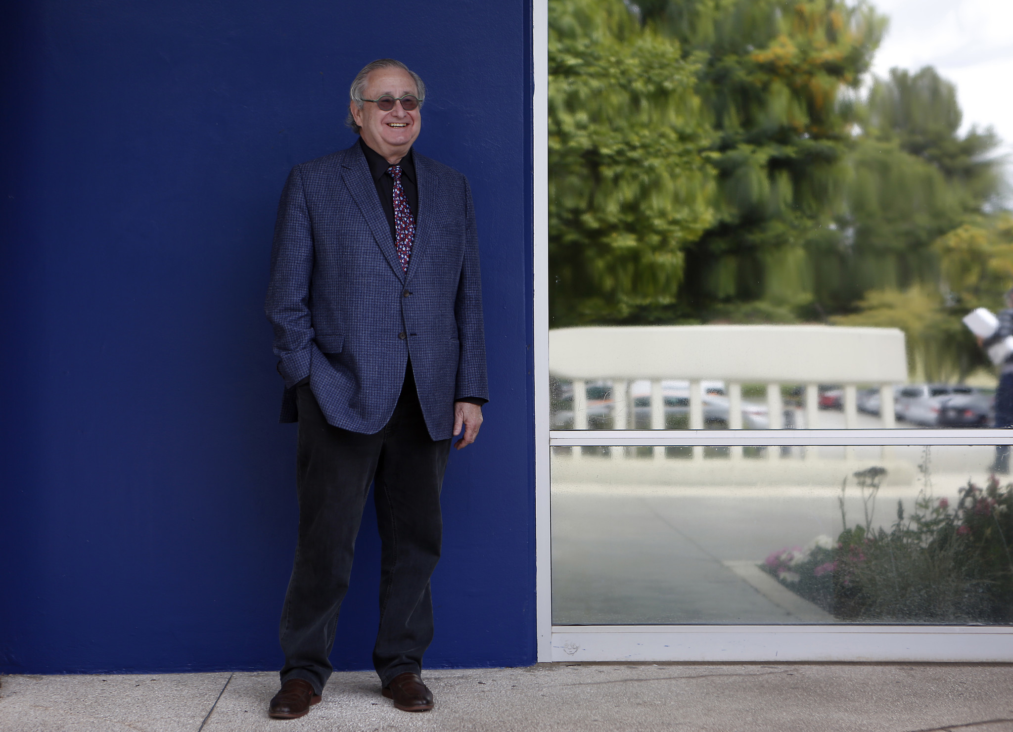 Steven Lavine in his final days as CalArts' third president — standing before the main building of the campus.