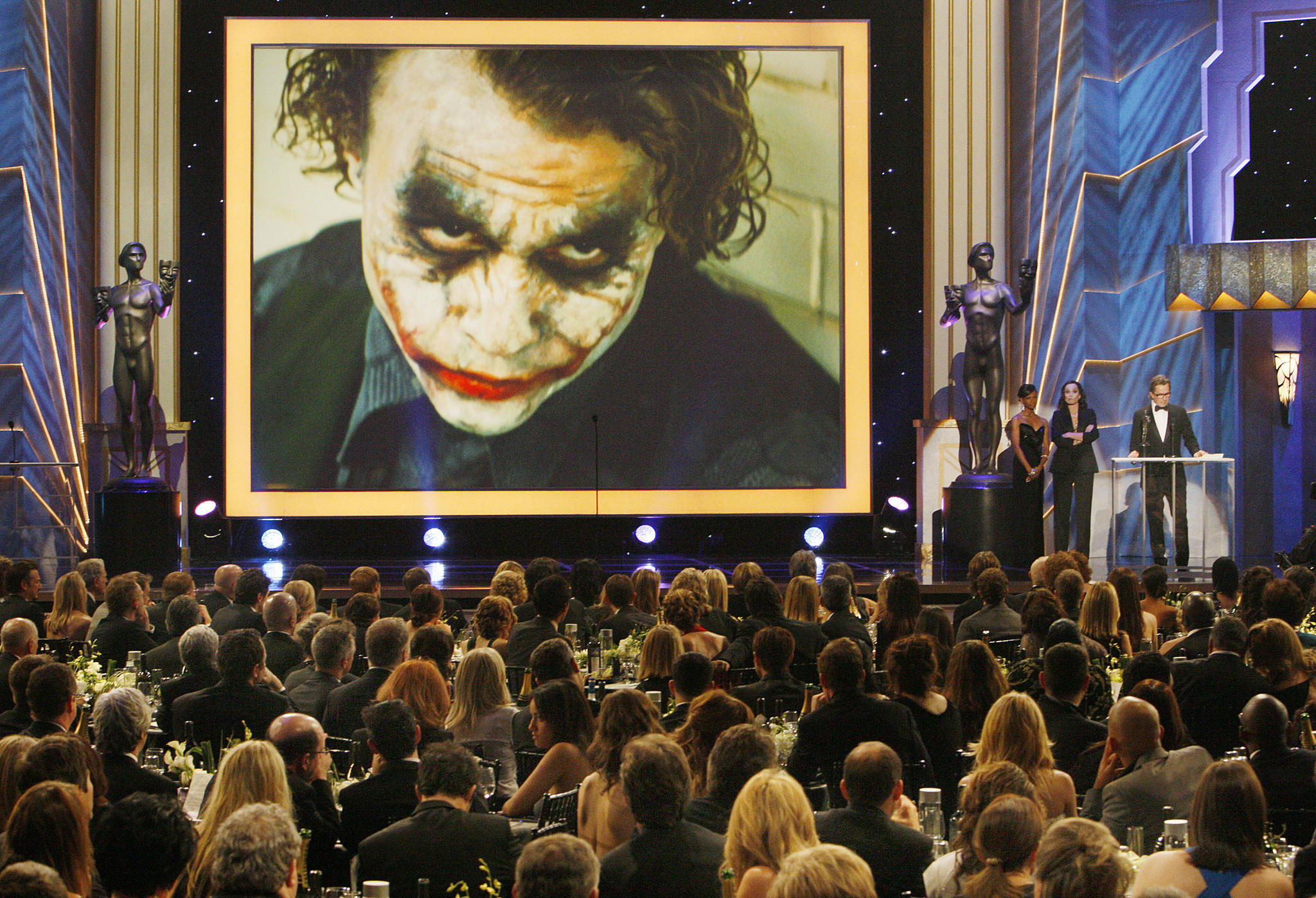 Gary Oldman accepts Heath Ledger's award for a male actor in a supporting role in