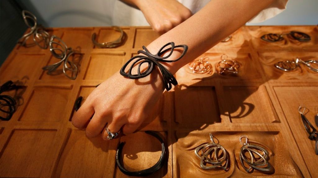 At her Silver Lake showroom, Wu shows a variety of jewelry items she makes using 3-D printing technology.