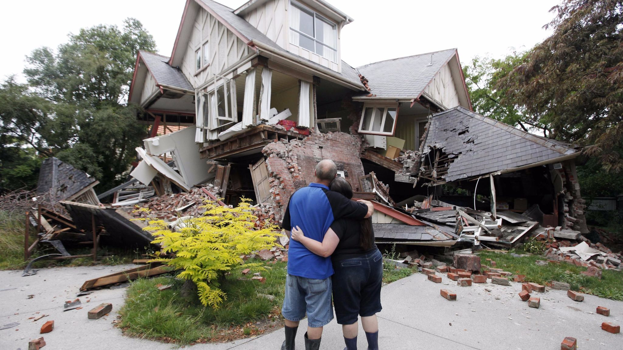 Murray and Kelly James look at their Christchurch, New Zealand, home, destroyed in an earthquake in 2011.