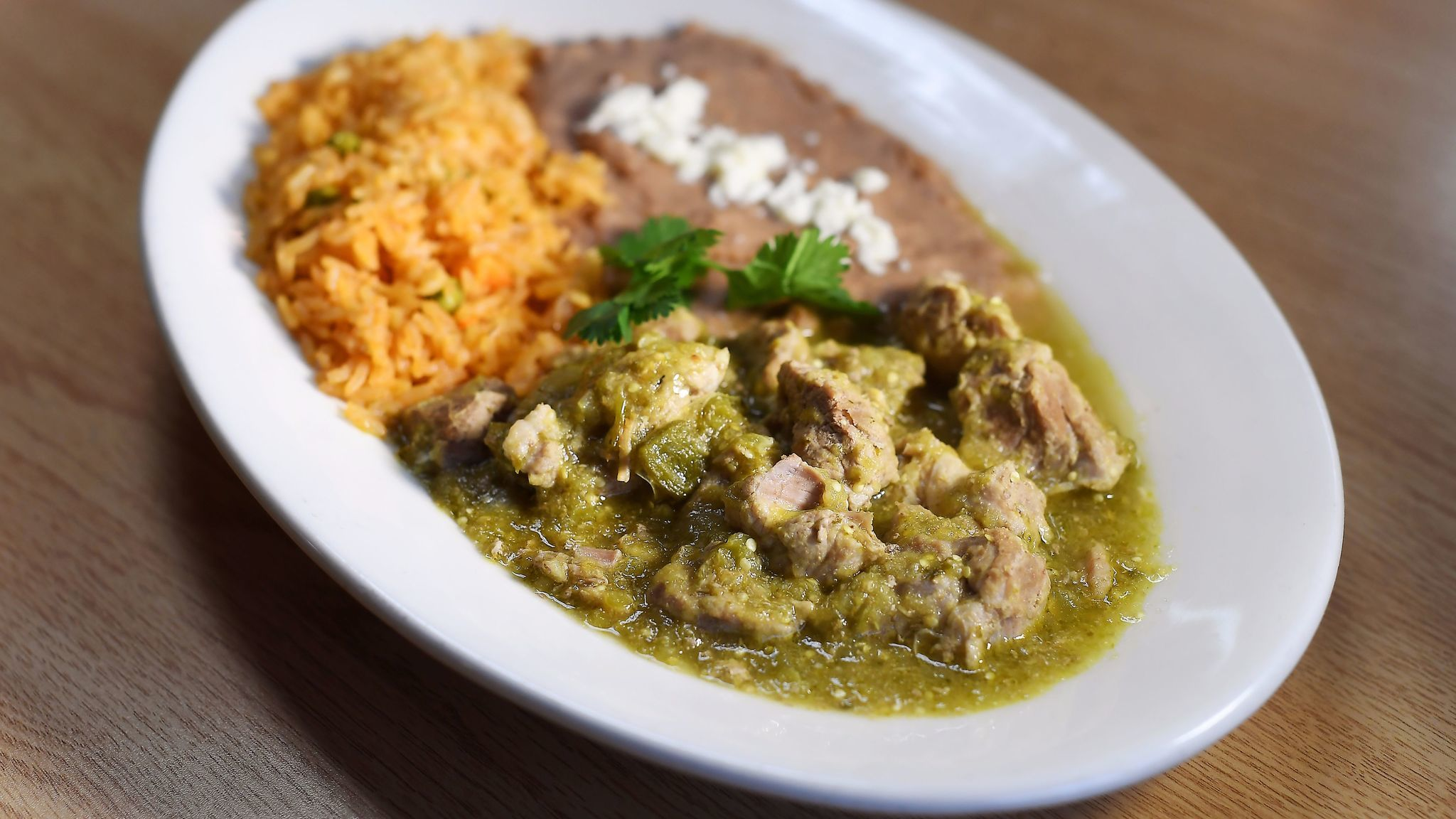 Chile verde is served with rice and beans, at Zapien's Salsa Grill and Taqueria in Pico Rivera.