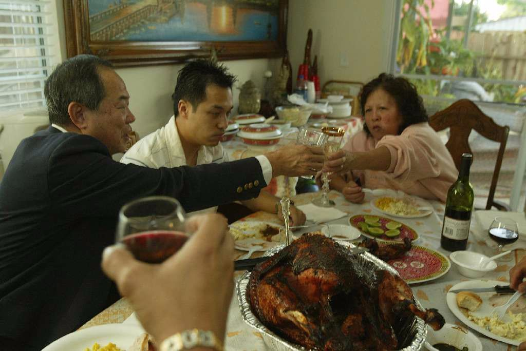 Ted Ngoy celebrates Thanksgiving with his family in 2004.