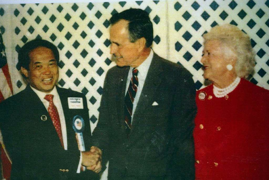Ted Ngoy shakes hands with President Bush in 1991.