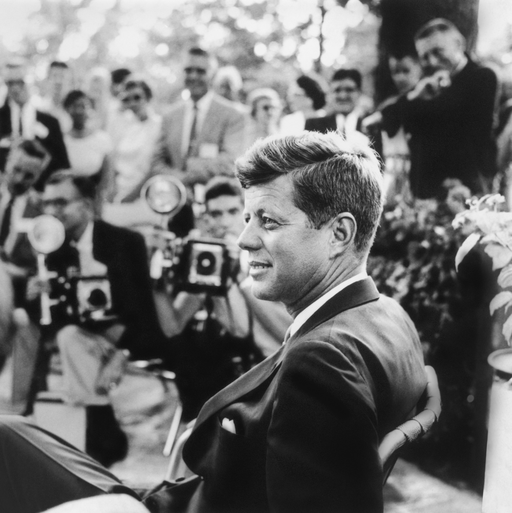 This photo of John F. Kennedy was taken at a 1959 press conference in Omaha, Neb. Jacqueline Kennedy later chose this image for her husband's memorial card.