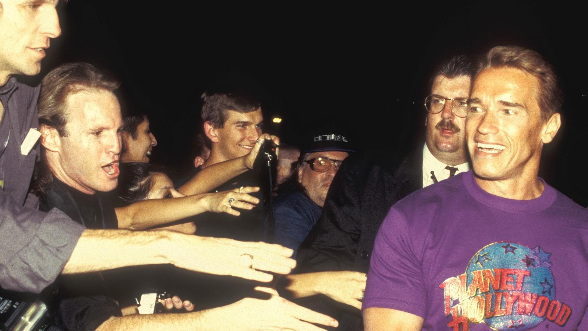 Fans greet Arnold Schwarzenegger as he arrives at the Forum Shops in July 1994.