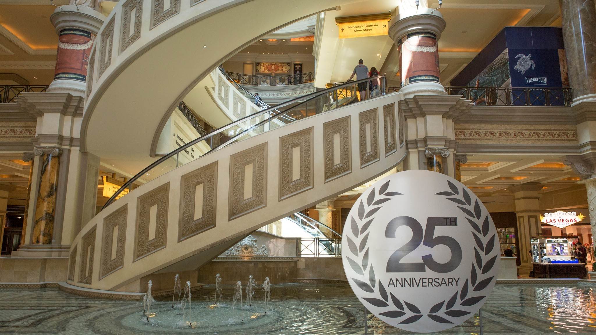 The three-story spiral escalator at the Forum Shops is the only conveyance of its kind in Las Vegas. People lined up to ride it following its launch in October 2004.