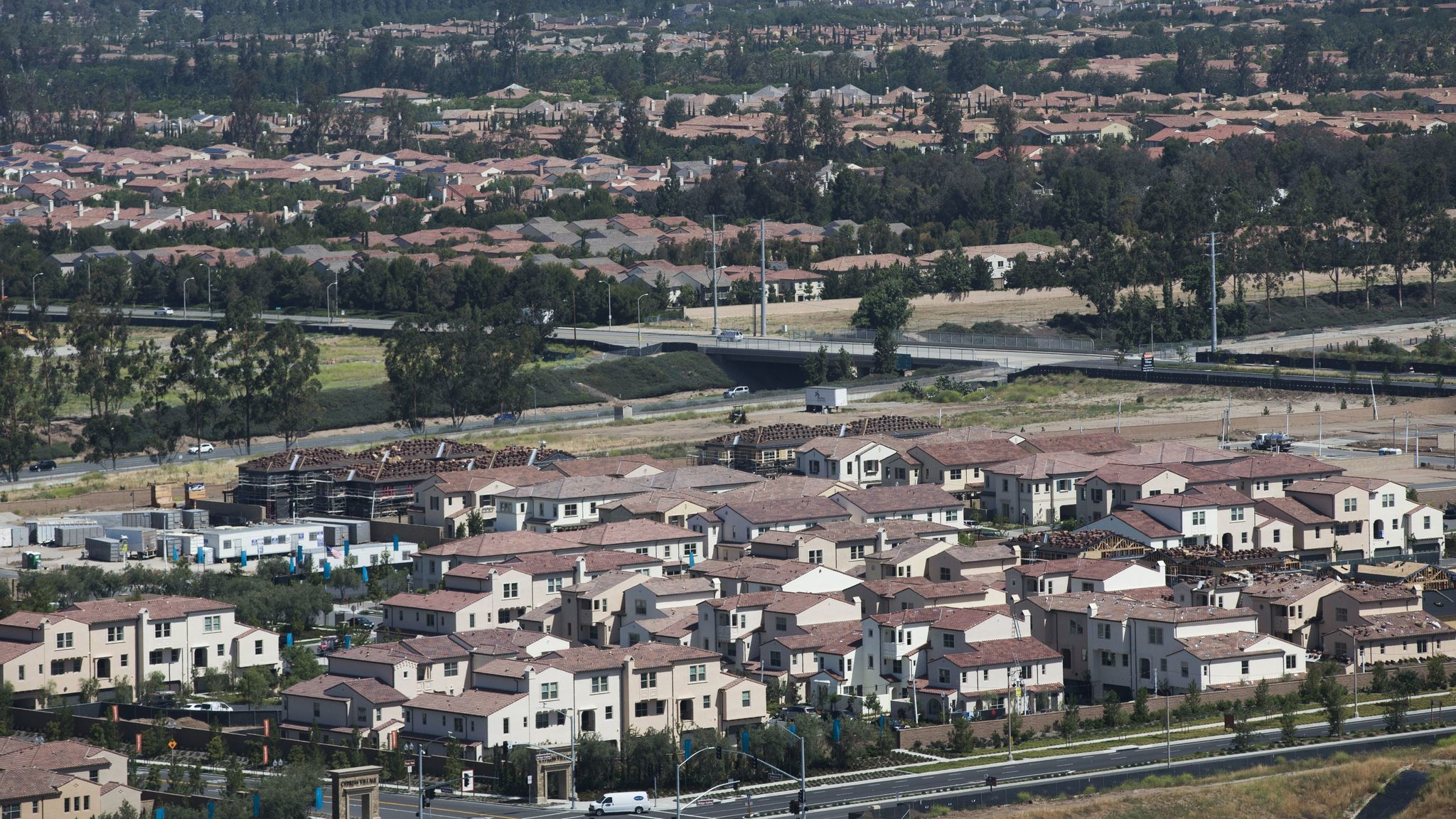 """A view from the Great Park balloon of newer neighborhoods in Irvine. Locals say they marvel at the pace of building in the town that they now call """"a metropolis."""" New developments abound in the city where the median age of residents is 34."""