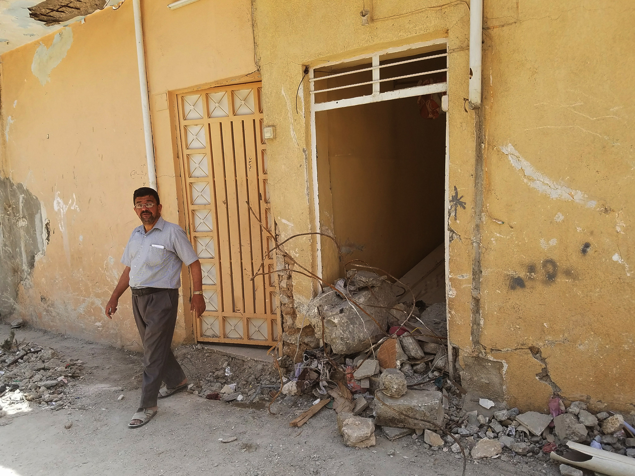 Mohamed Fadil, 38, said he was forced to bury his wife, cousin and cousin's wife in his yard after they were killed in an airstrike March 17 in west Mosul's Jadidah neighborhood.