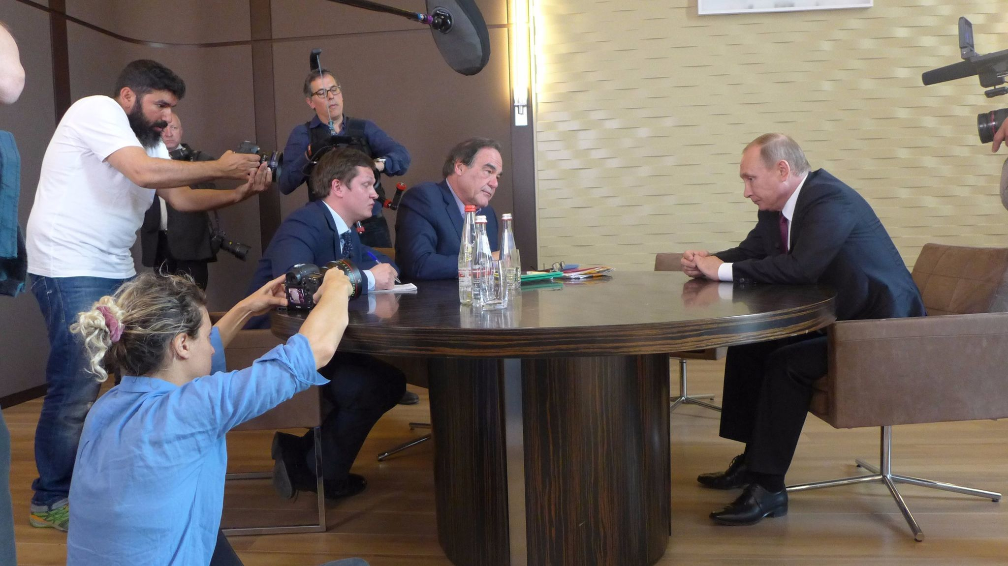 "Pictured (seated): Interpreter Sergei Chudinov, Oliver Stone and Russian President Vladimir Putin in the Showtime documentary ""The Putin Interviews."""