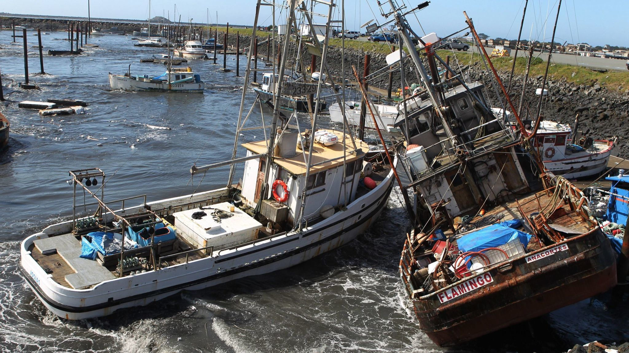 In this March 11, 2011 file photo, boats collide with one another after a tsunami swept through a boat basin in Crescent City, Calif.