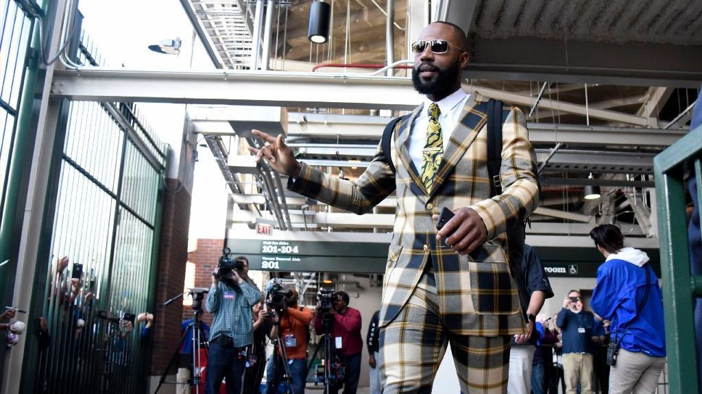 "Chicago Cubs right fielder Jason Heyward (22) departs for a road trip wearing a suit based on the character Ron Burgundy from the movie ""Anchorman"" after a game against the San Francisco Giants at Wrigley Field."