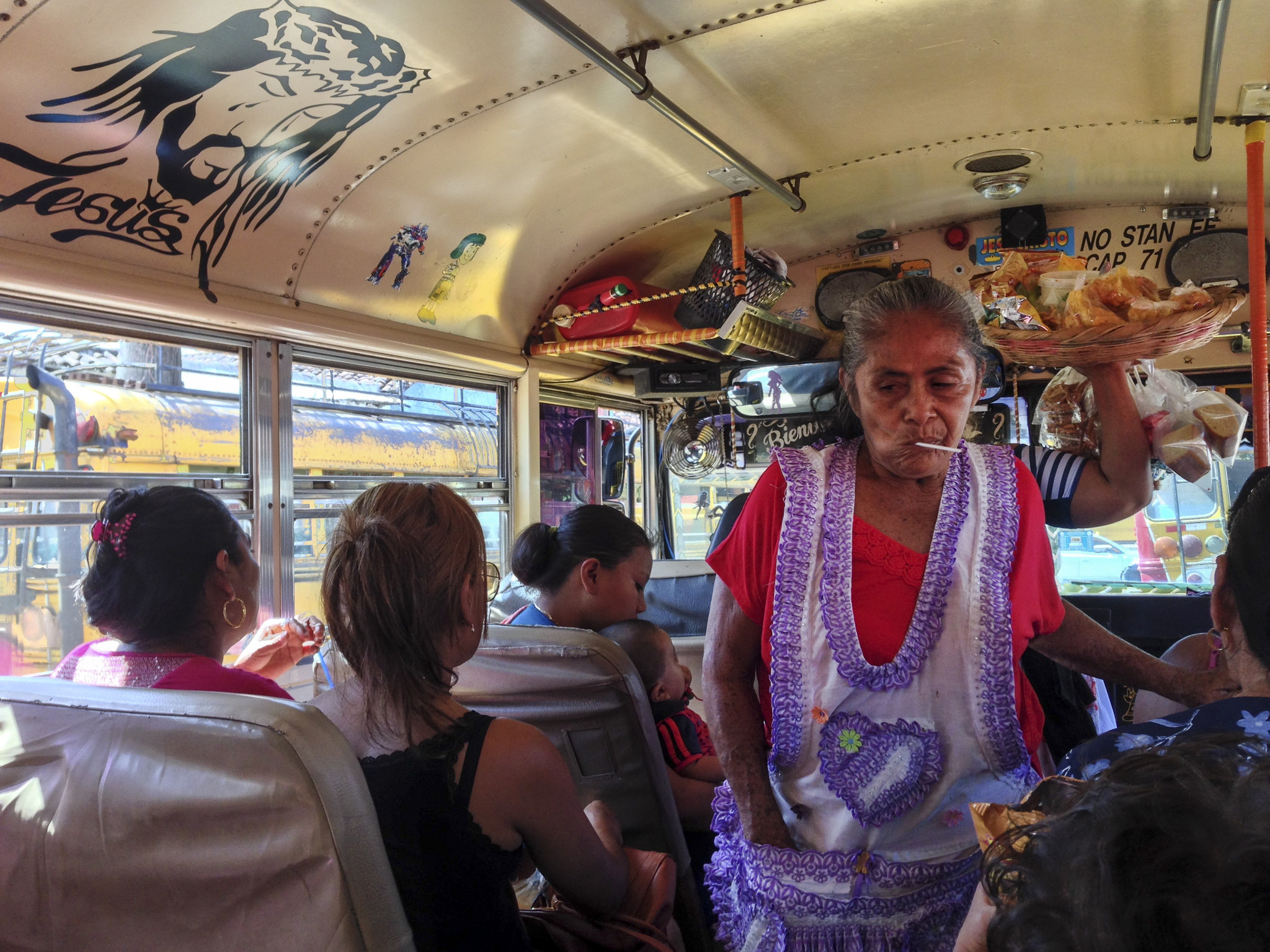A vendor selling fried plantains and other treats squeezes through the aisle on one of the many chicken buses that Katie Quirk and her family rode during their stay in Granada, Nicaragua.