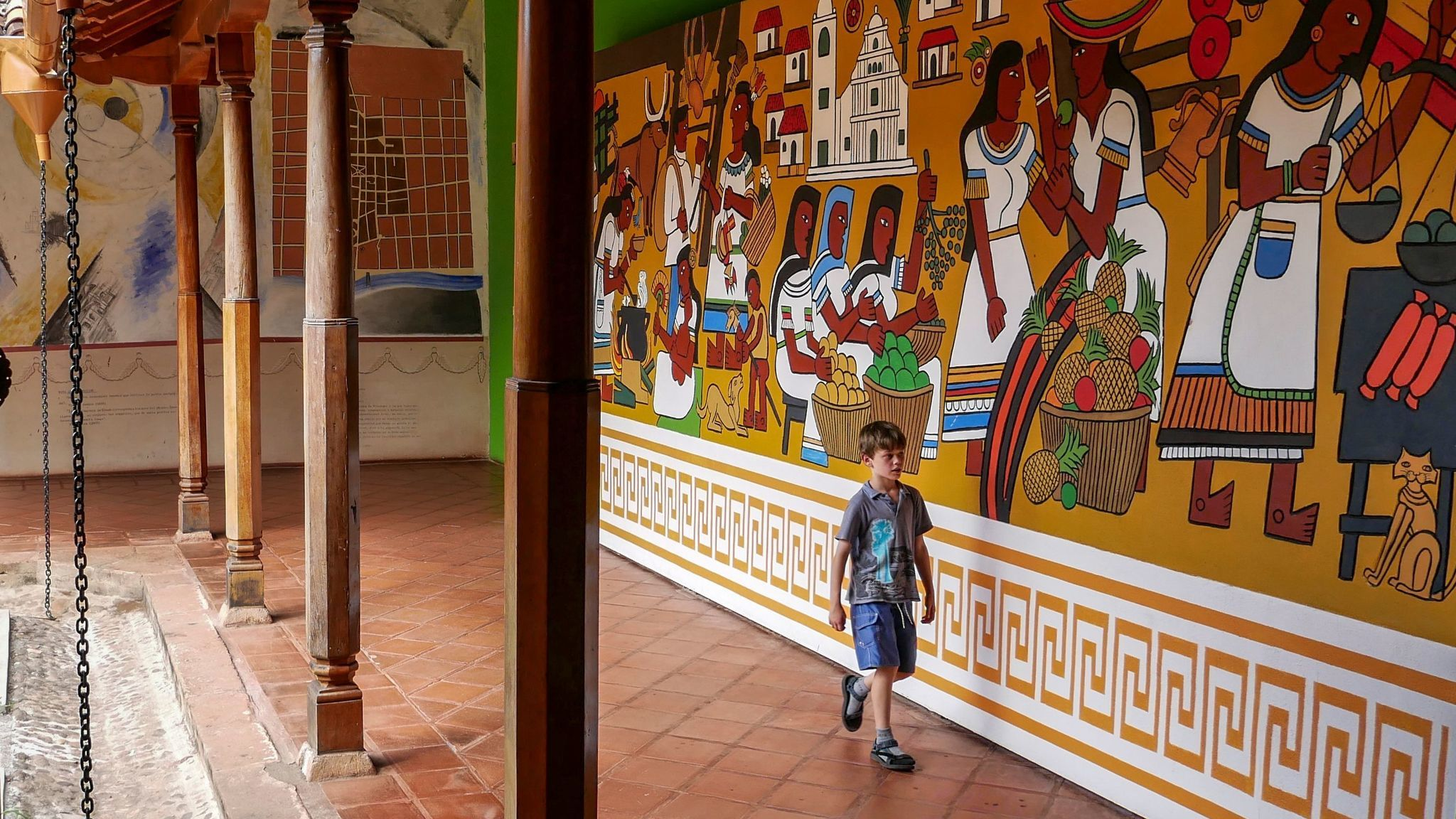 Liam searches for answers during a family treasure hunt in Granada's cultural museum housed in the San Francisco Convent.