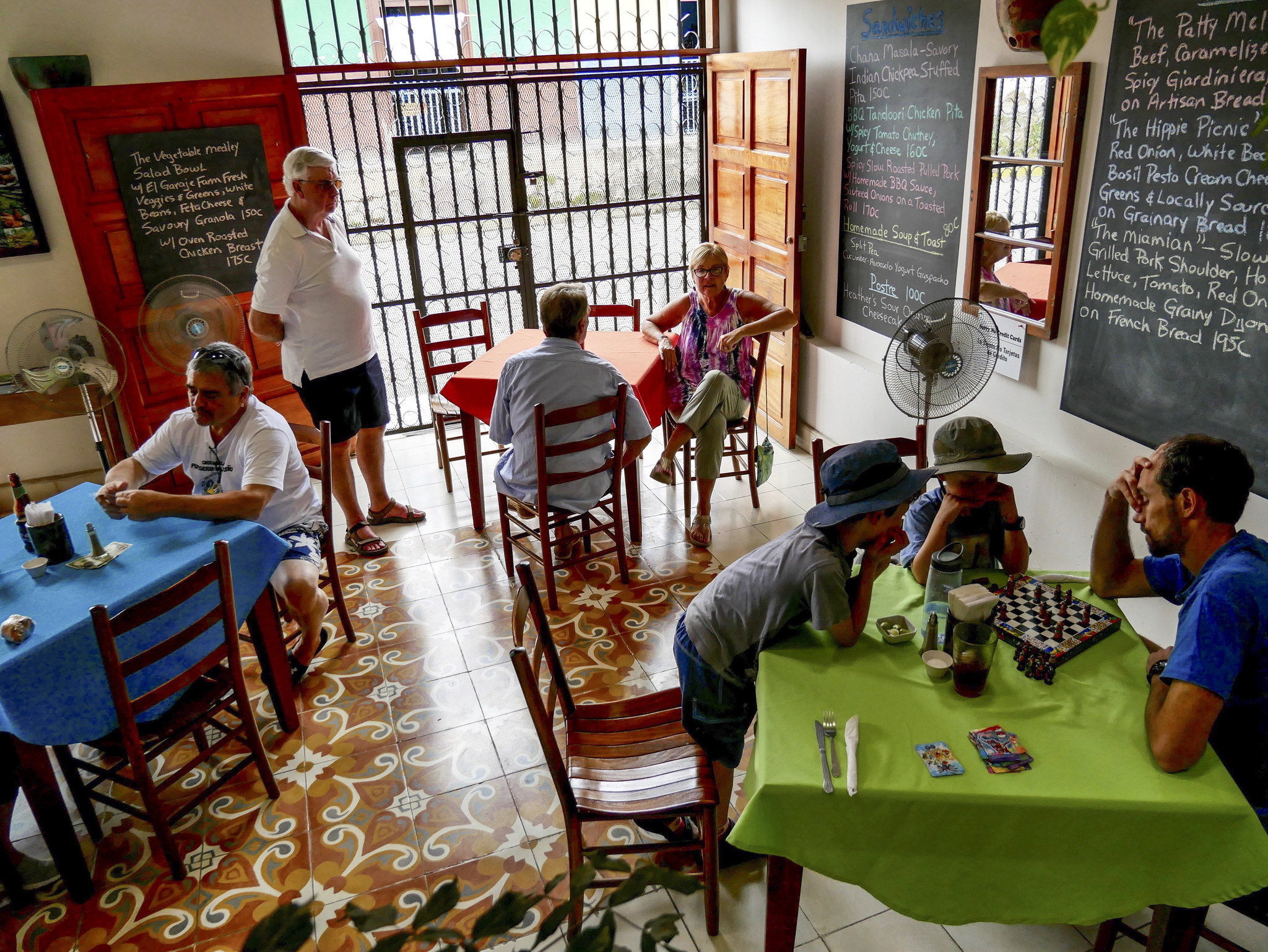 Tim Waring plays chess with Liam and Reid while the family waits for lunch at Restaurante El Garaje in Granada.