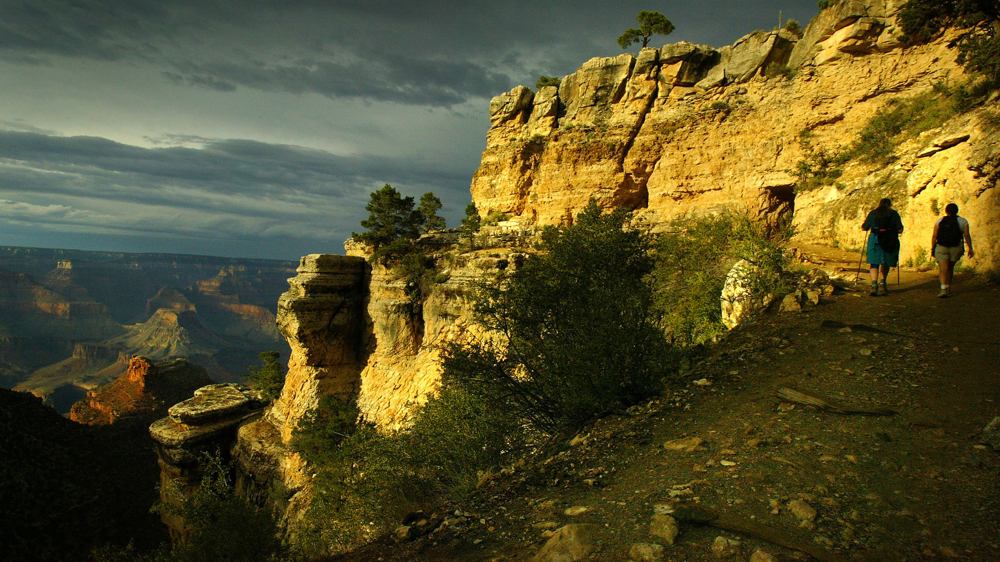 Hikers walk along the Bright Angel Trail in Arizona's Grand Canyon National Park.