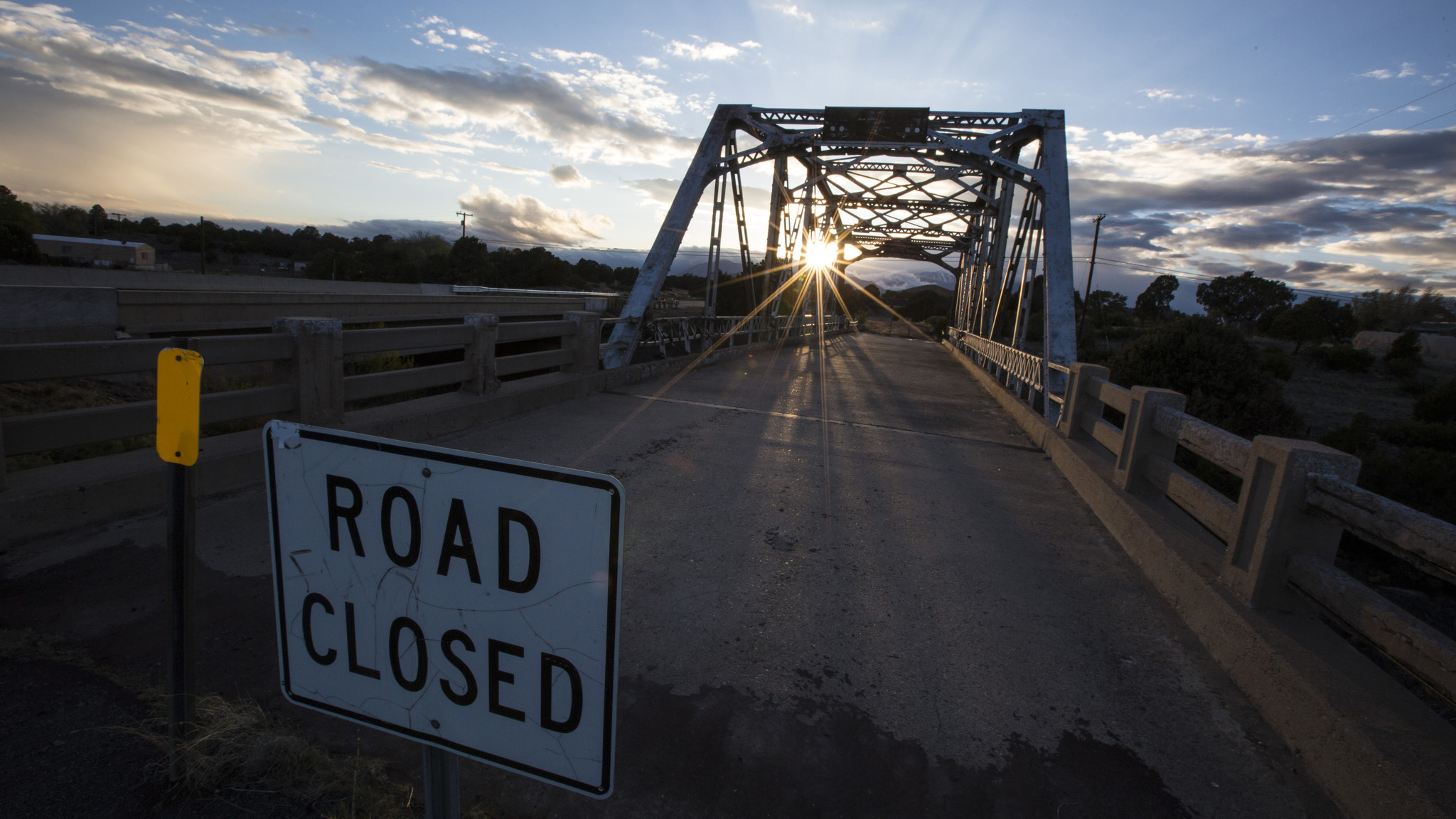 The sun sets behind the now closed Walnut Canyon Bridge.
