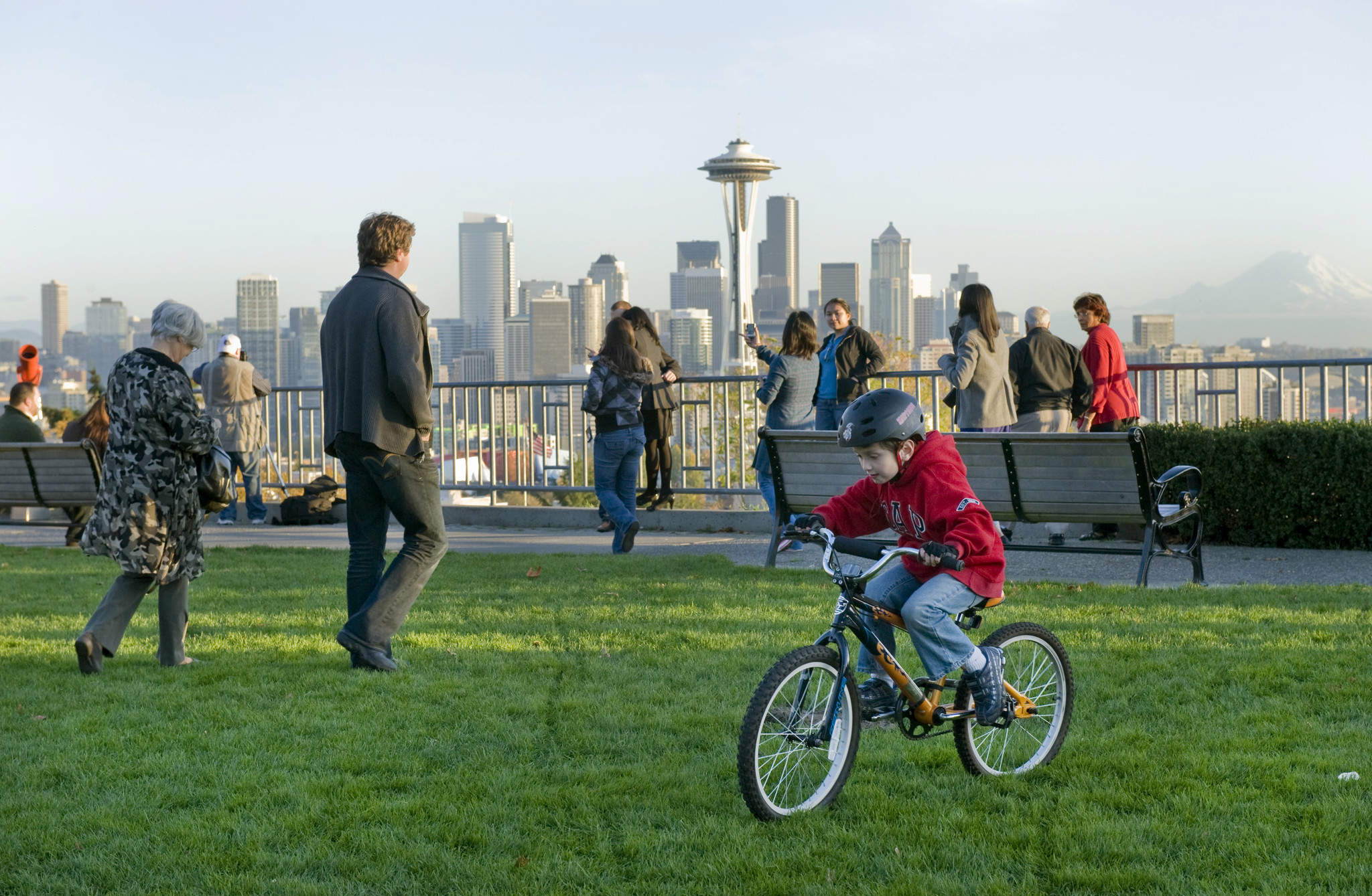 Visitors enjoy a view of Seattle from Kerry Park.