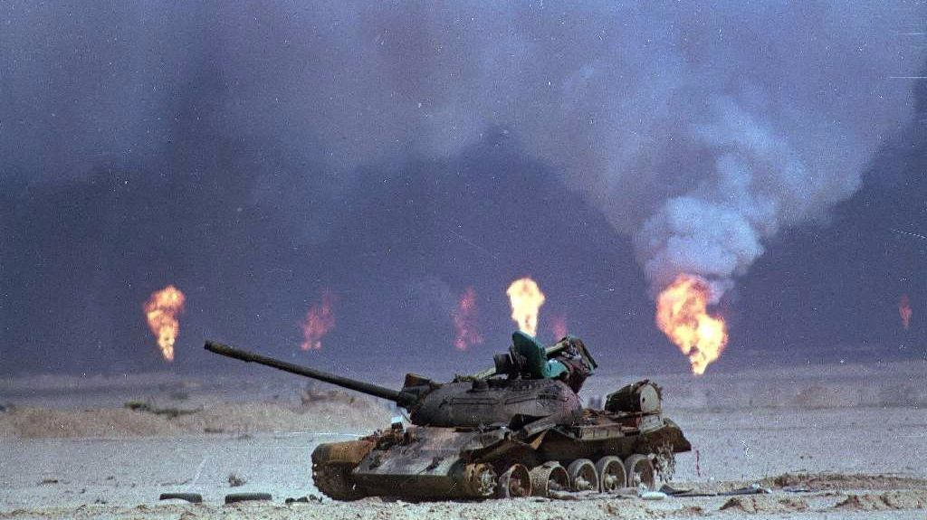 A destroyed Iraqi tank is shown near a series of oil well fires in the aftermath of the Persian Gulf War in this March 9, 1991, photo in northern Kuwait.