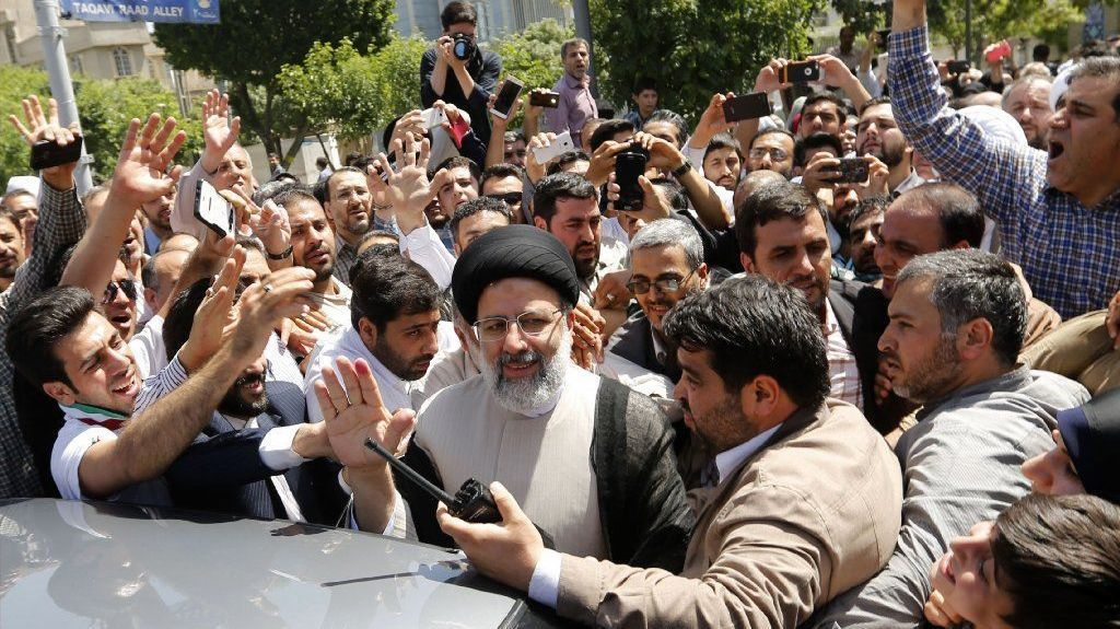 Ebrahim Raisi greets supporters after casting his ballot in the May 19 Iranian presidential election. Raisi finished second but raised his public profile.