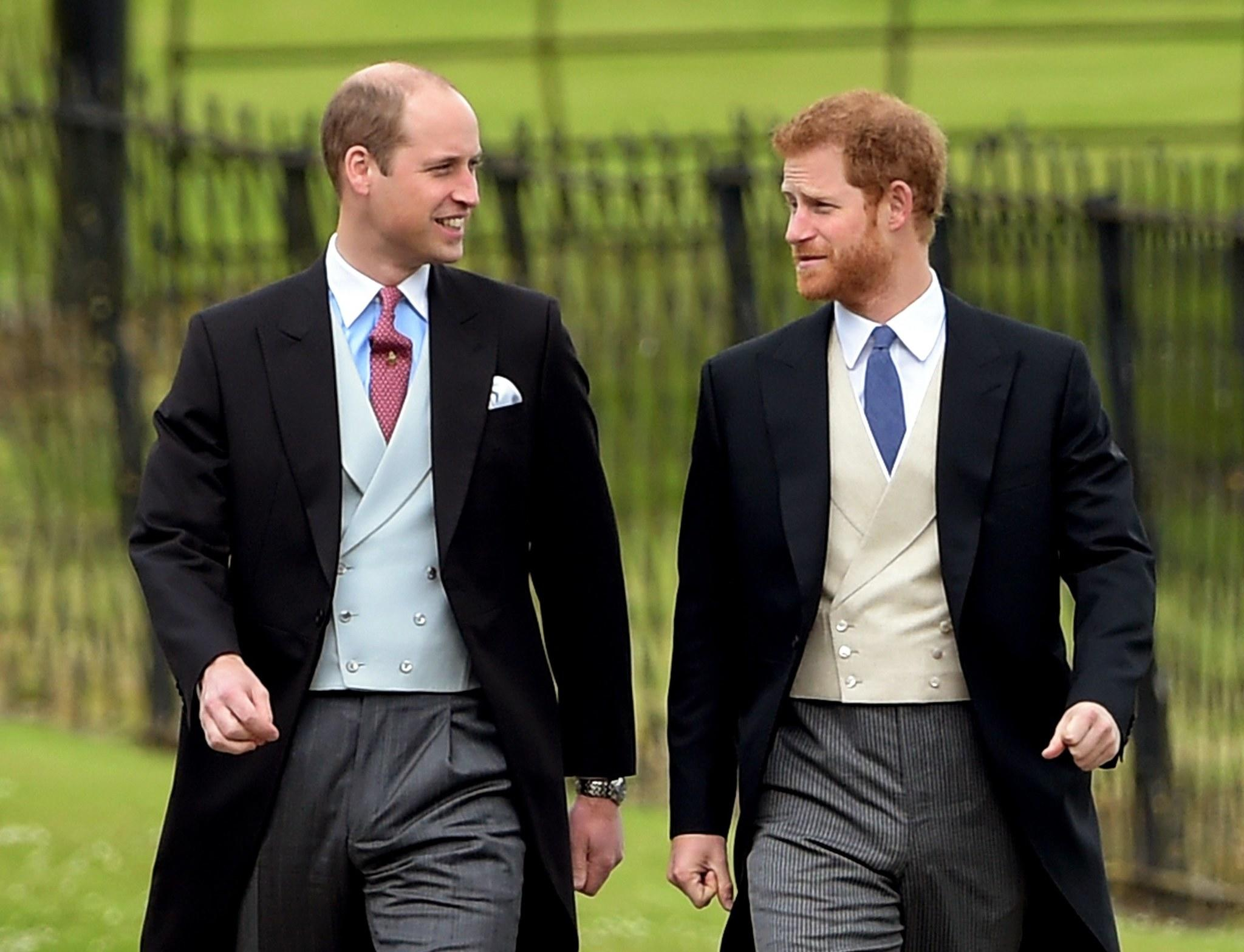 Prince William, left, and Prince Harry attend the wedding of Pippa Middleton on May 20, 2017. (EPA)