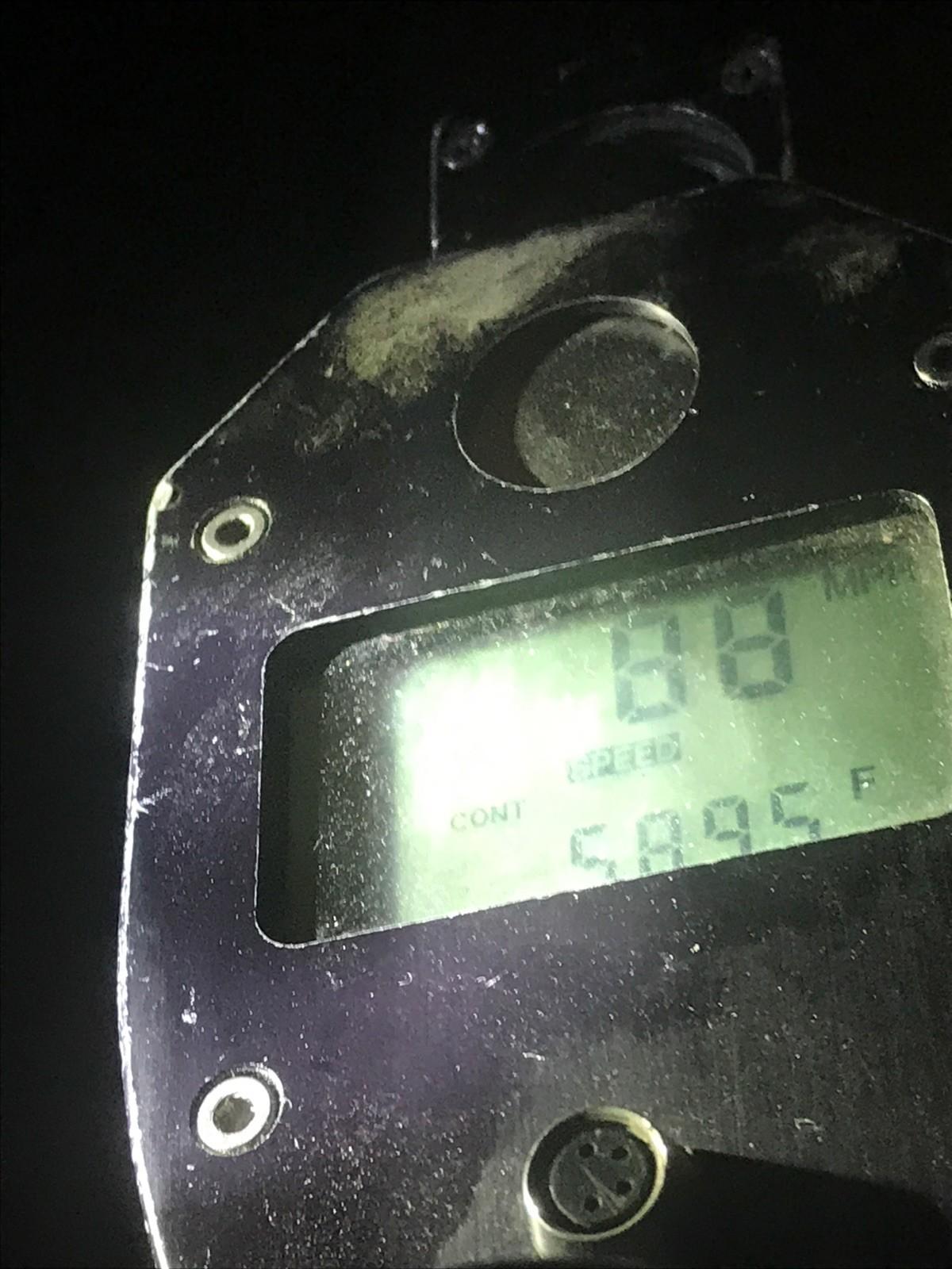 A CHP officer's radar gun showing a speed of 88 mph.
