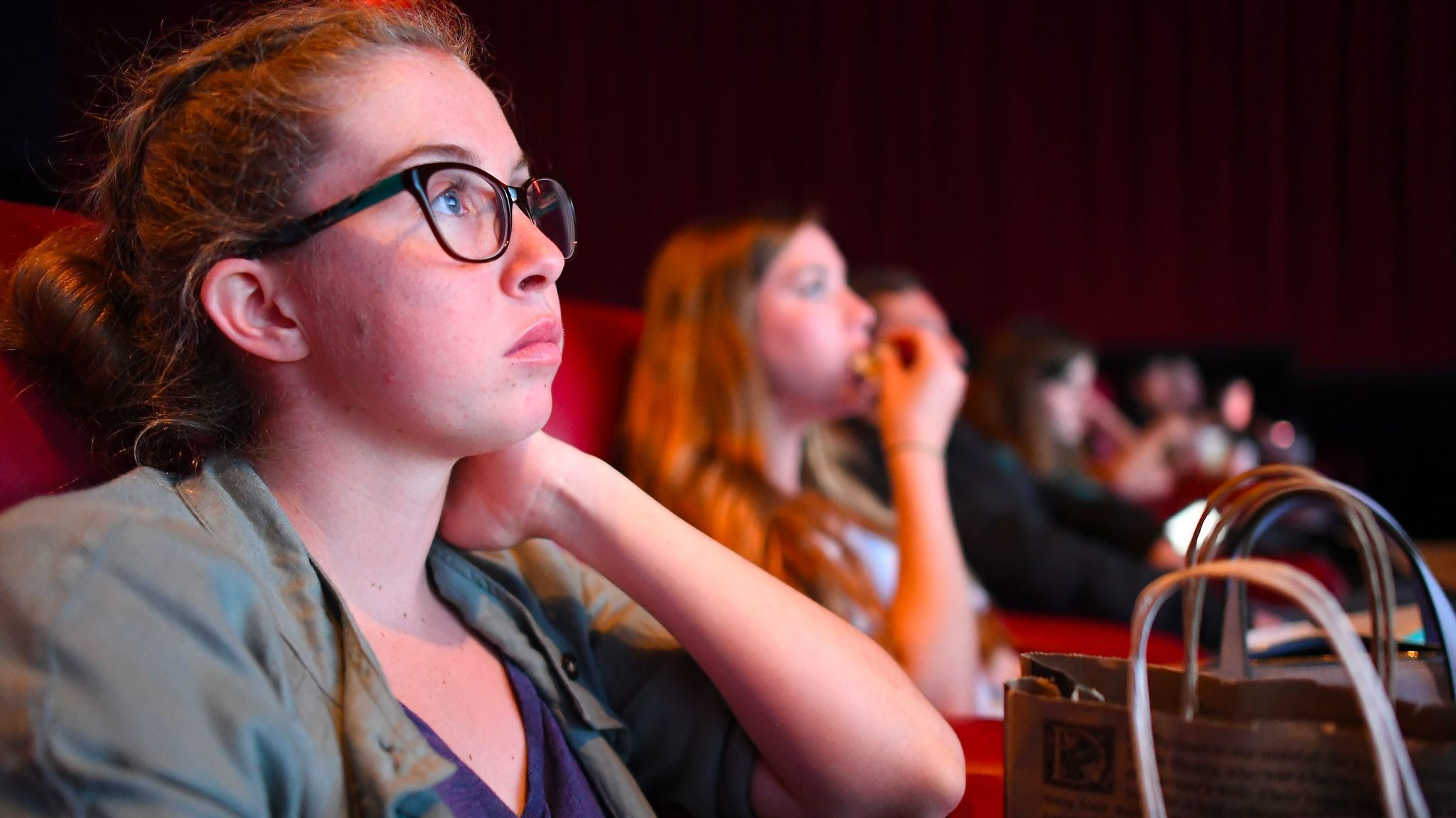 """If we're gonna be hanging out on the [Third Street] Promenade, we might as well go to a movie,"" says Morgan Gerlach, shown watching  ""Baywatch"" in Santa Monica."