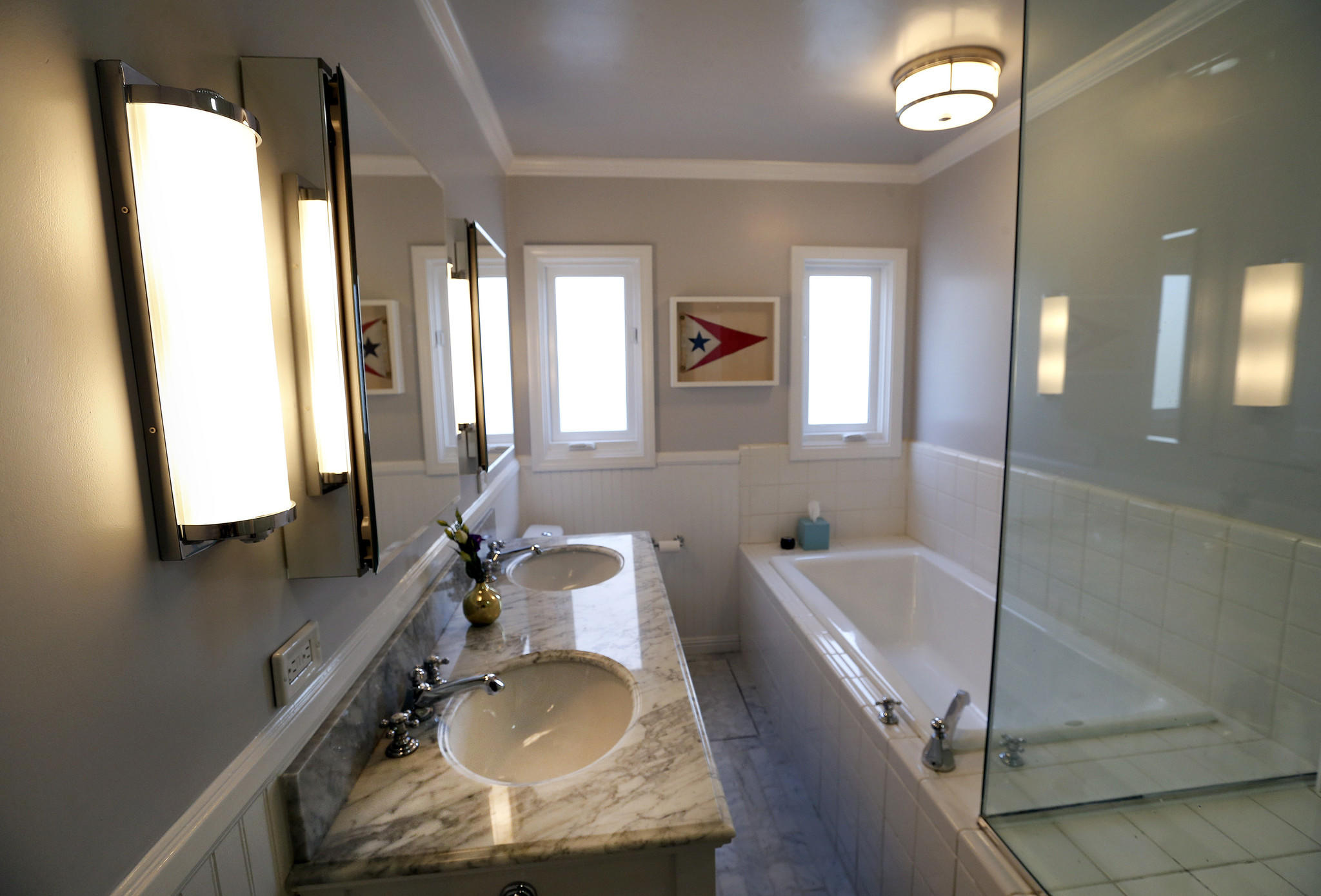 The main bathroom features a new vanity with carrera marble countertop and floor.