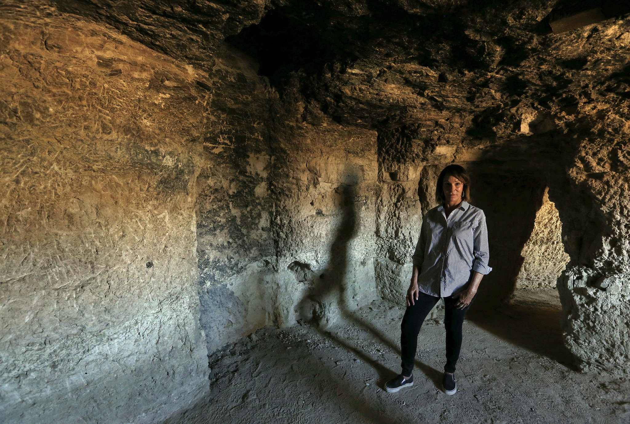 Susan Sorrells, owner of the town of Shoshone, is photographed inside a cave at Dublin Gulch, one of a network of caves built by miners to live in, back in 1925 until the late 1950s. The caves are made out of caliche and volcanic ash.