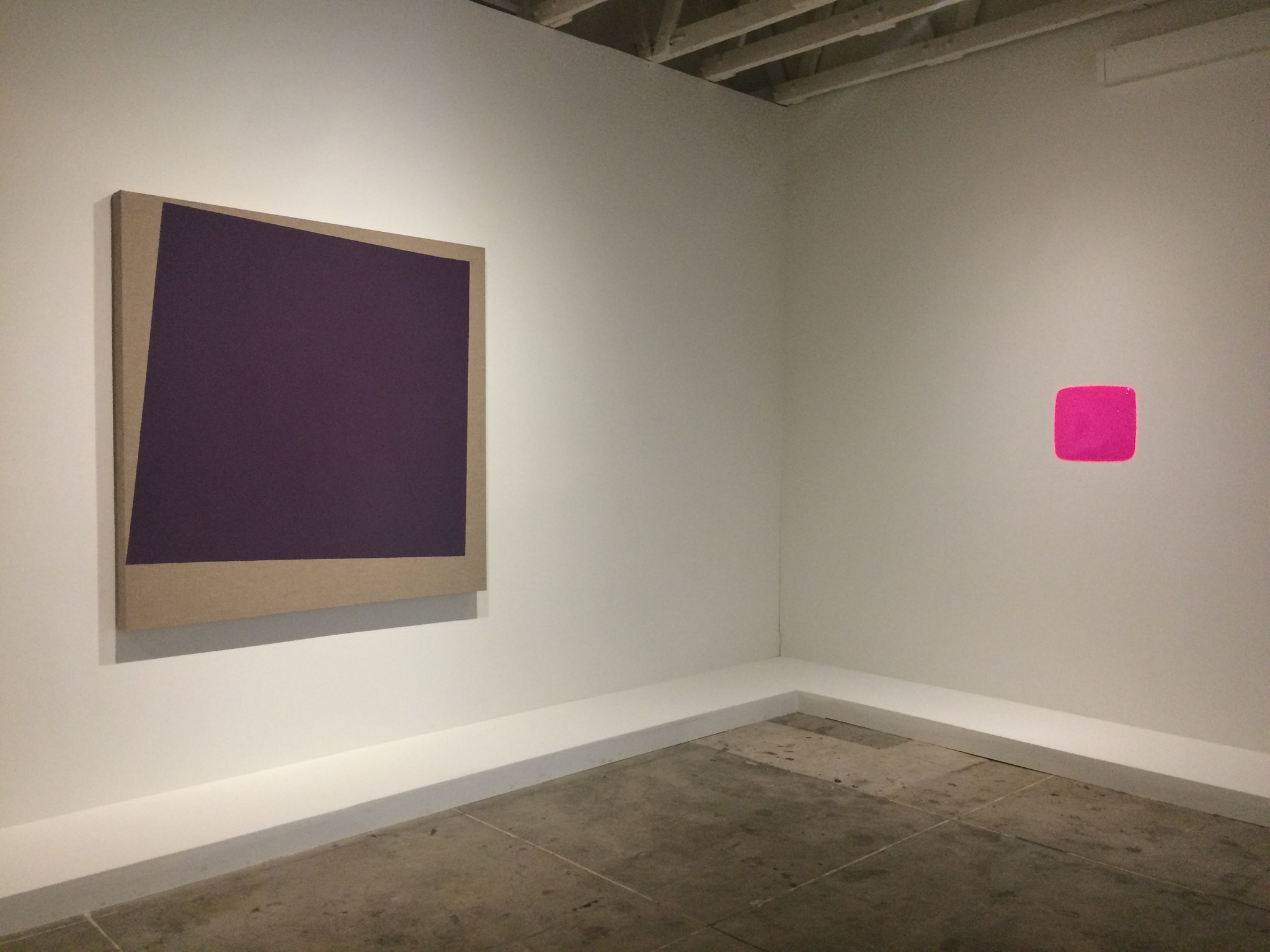 An installation view of works by Noah Davis, left, and Conceptualist Michael Asher riff on the meaning of color.