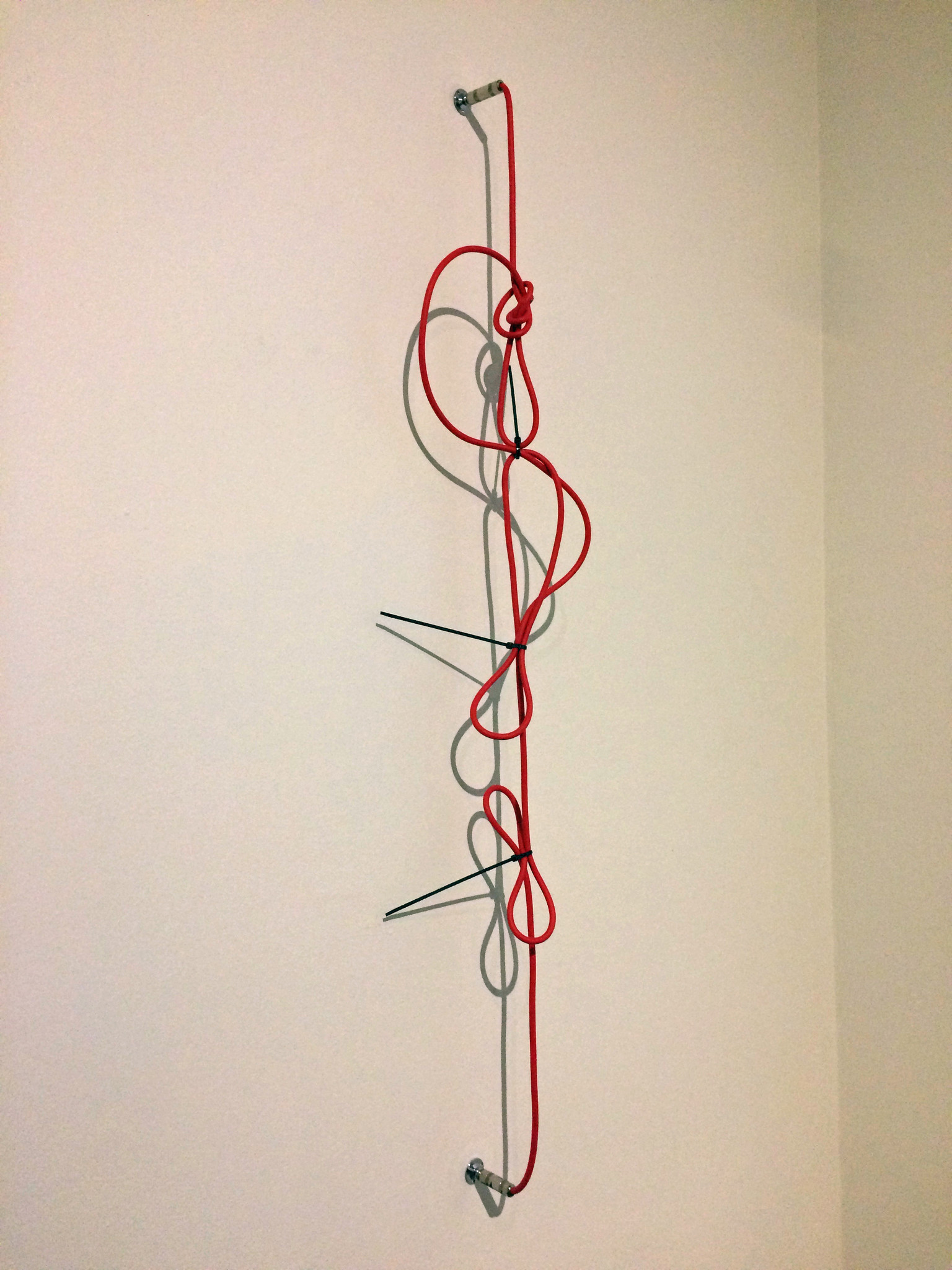"""SHHH, The Red Series #2,"" by Jennie C. Jones, a wall piece from 2014 that plays with form and color."