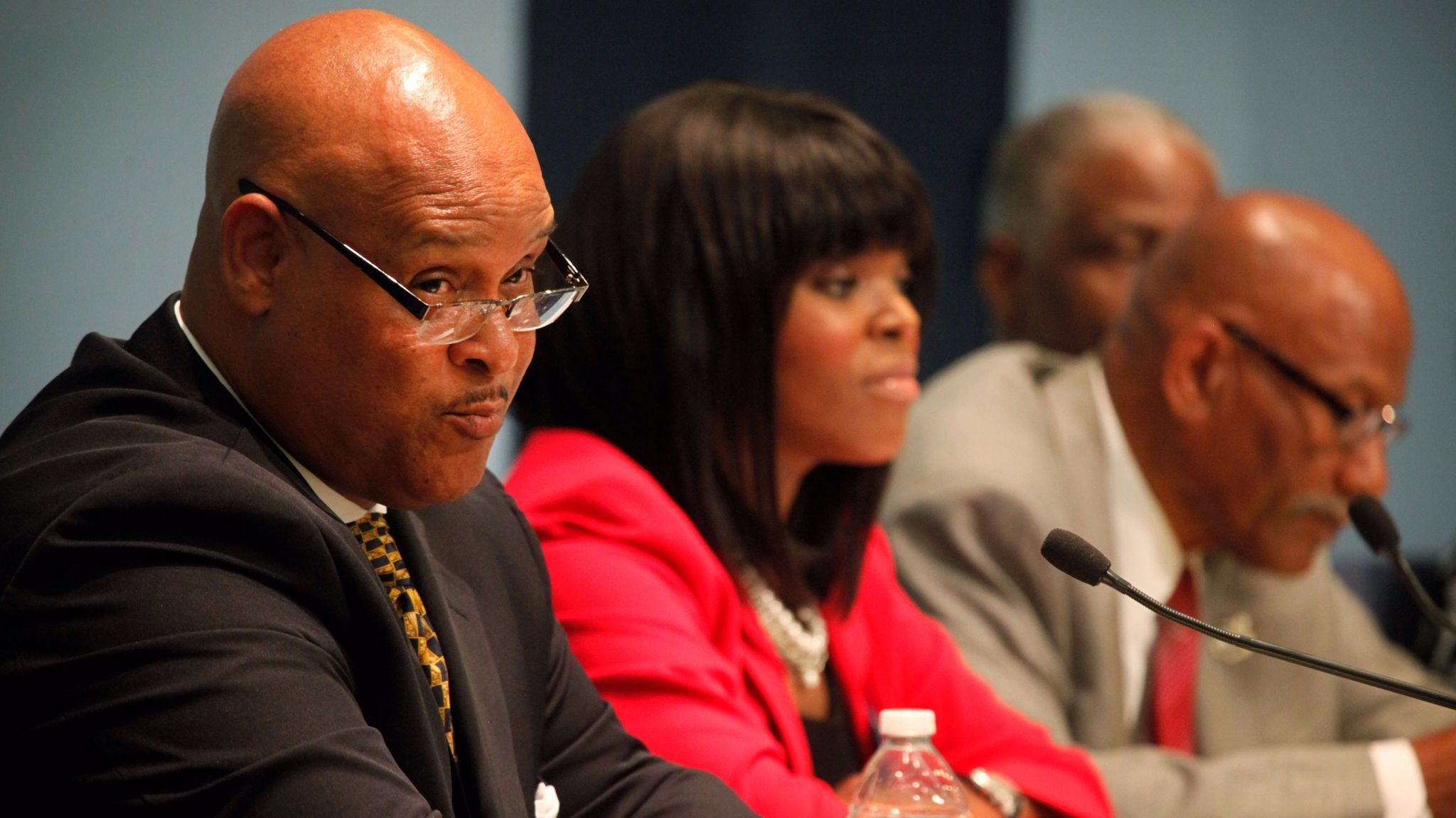 Omar Bradley and Aja Brown speak at a mayoral candidate forum in 2013.
