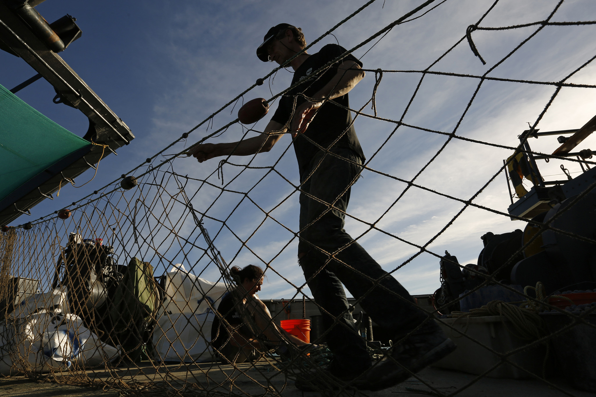 Sea Shepherd activists work to break down illegal gill nets and other illegal fishing lines used by