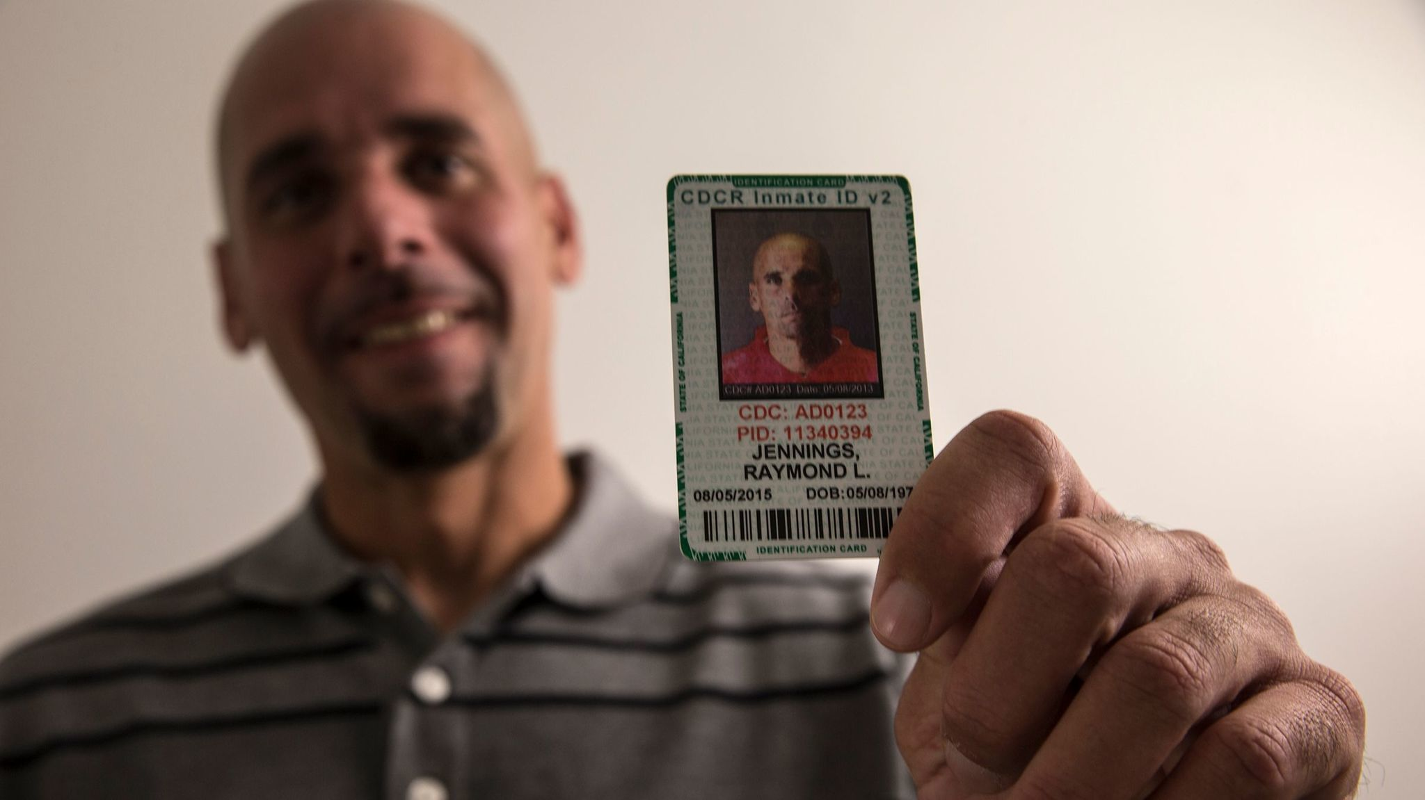 Raymond Lee Jennings holds his prison identification card. Now a free man, he spent 11 years behind bars for murder before the case against him unraveled in dramatic fashion.