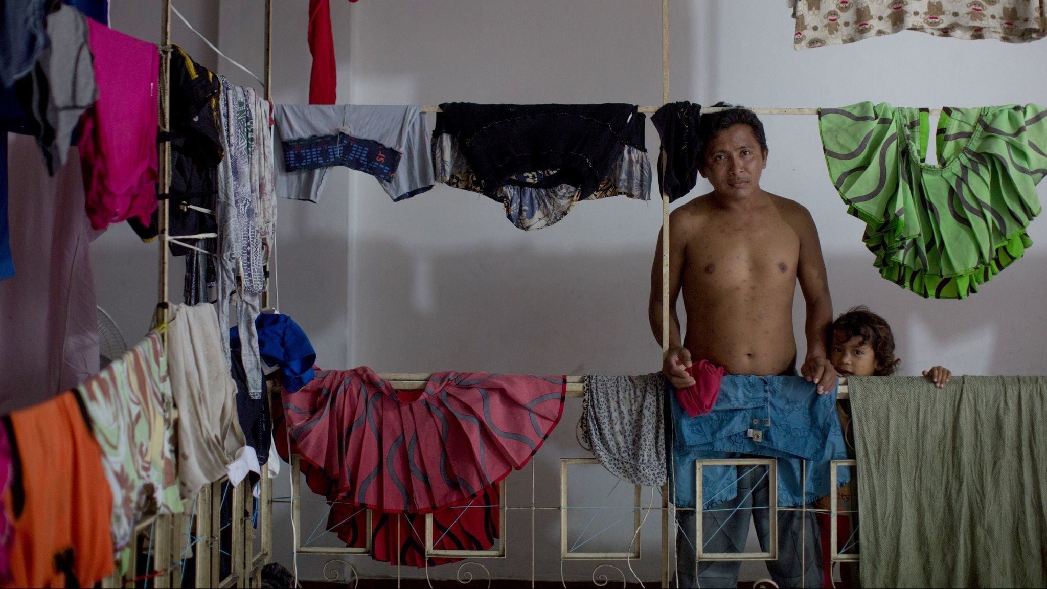 Bergassio Quiñonez traveled with his wife and two daughters to Manaus, Brazil, when food became scarce in Venezuela.