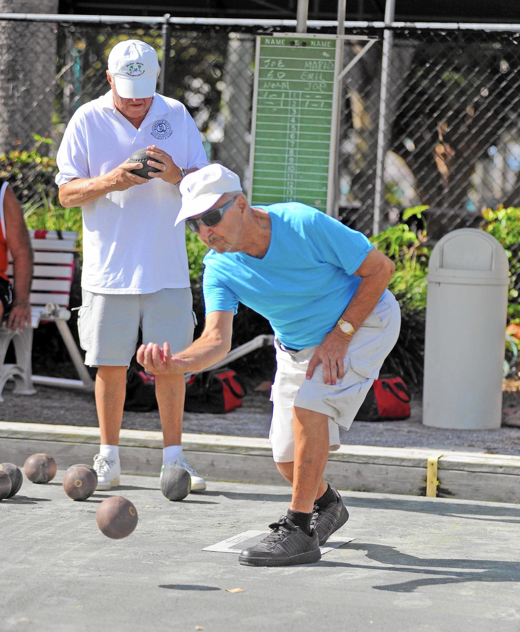 Seniors compete in lawn bowling at veterans park rec - Palm beach gardens recreation center ...