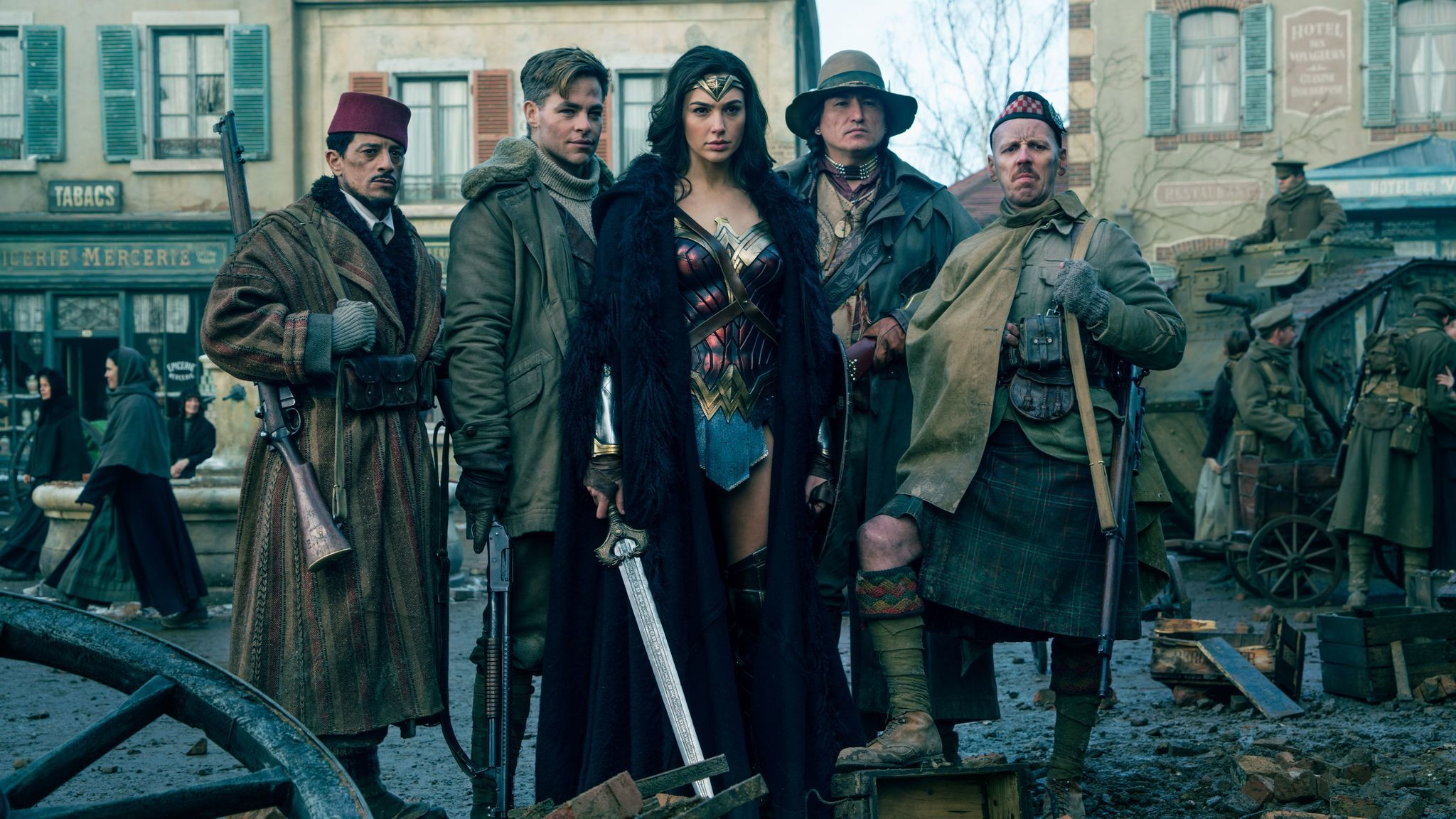 "Said Taghmadui, left, as Sameer, Chris Pine as Steve Trevor, Gal Gadot as Wonder Woman, Eugene Braverock as the Chief and Ewen Bremner as Charlie in ""Wonder Woman."""