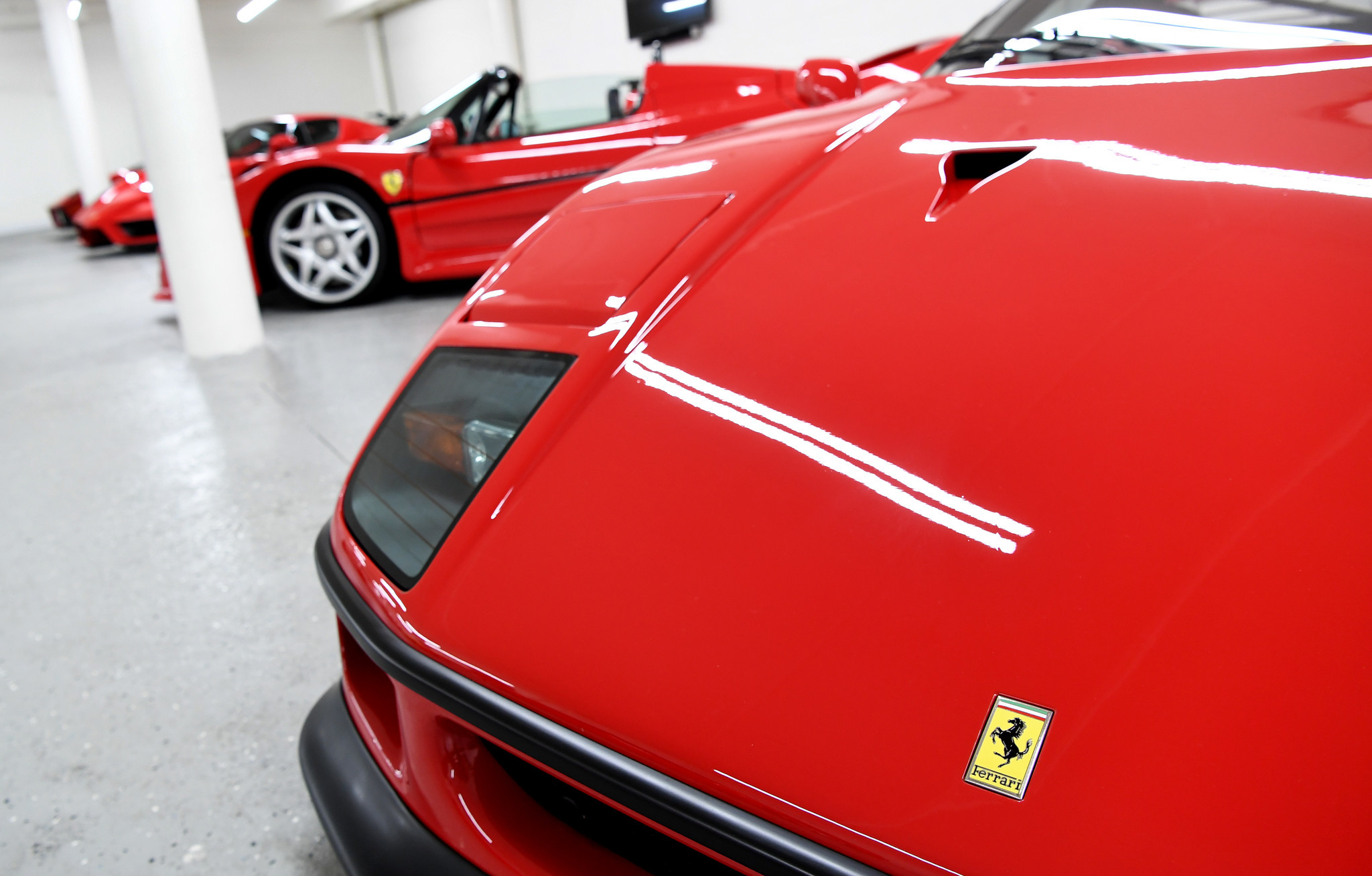 Among Lee's Ferraris are five matching red models.