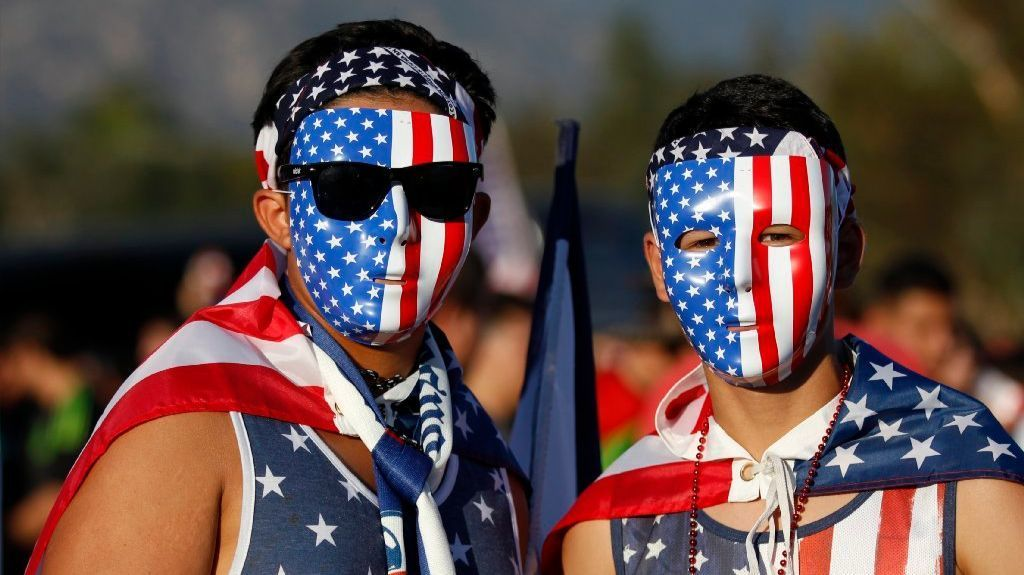 U.S. fans Raul Diaz and Alonzo Tovar, right, show off their masks and outfits at the sold out 2015 CONCACAF Cup match between the United States and Mexico at the Rose Bowl on Oct. 10, 2015.