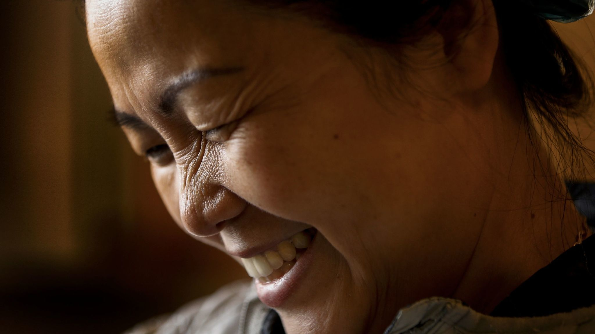 Hue Phan says she finds fulfillment in her Buddhist religion, volunteering to help cook on weekends at the temple.