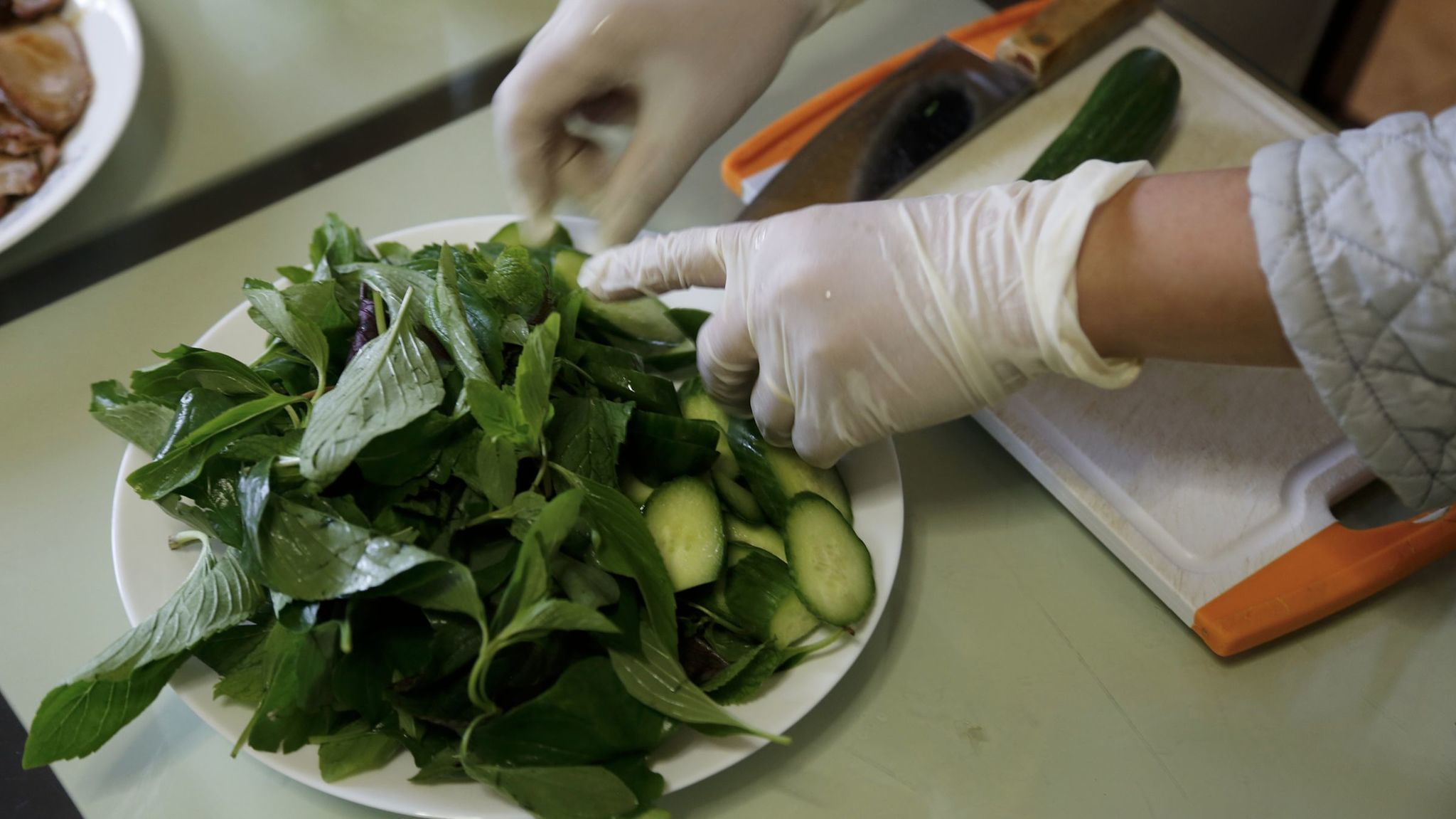 As part of this afternoon's lunch, Hue Phan offers a salad bursting with fresh lettuce, cucumber and mint.